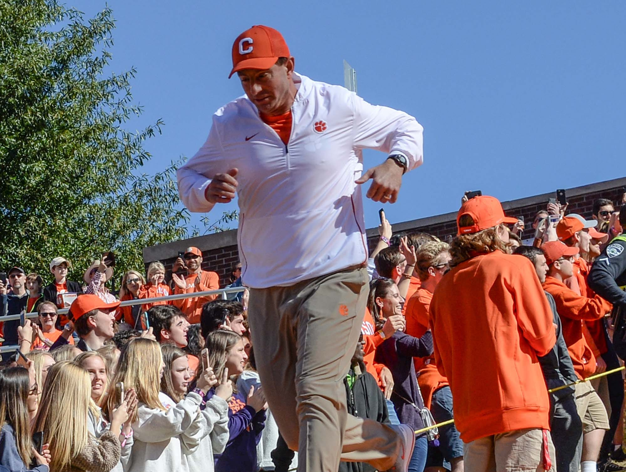 Clemson Head Coach Dabo Swinney runs down the hill before the game with Louisville in Memorial Stadium on Saturday, November 3, 2018.