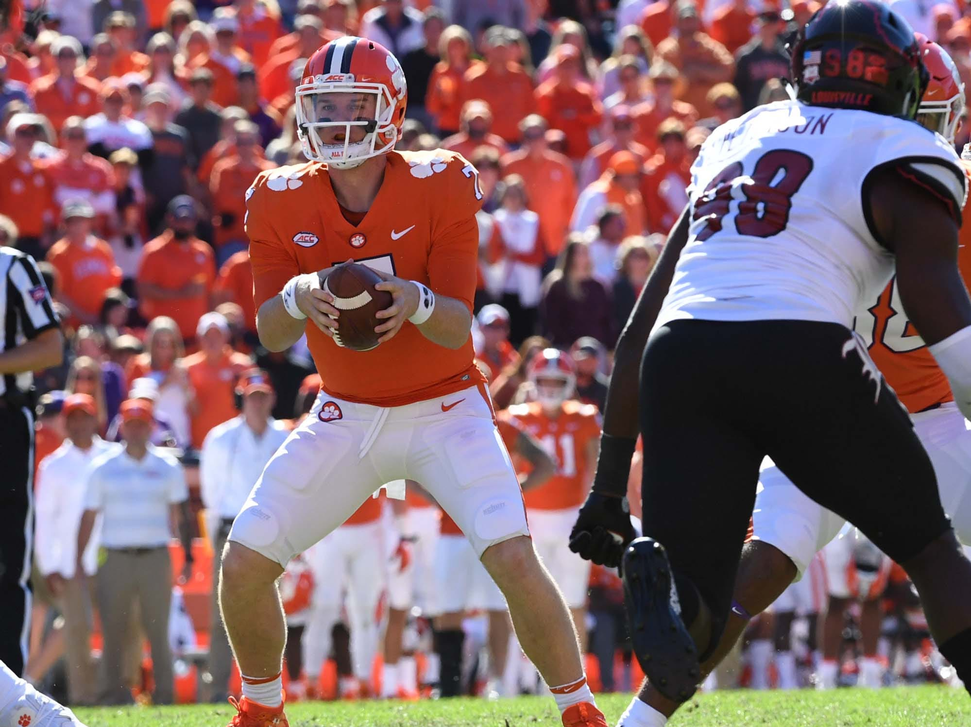 Clemson quarterback Chase Brice (7) takes a snap near Louisville defensive end Tabarius Peterson(98) during the fourth quarter in Memorial Stadium on Saturday, November 3, 2018.