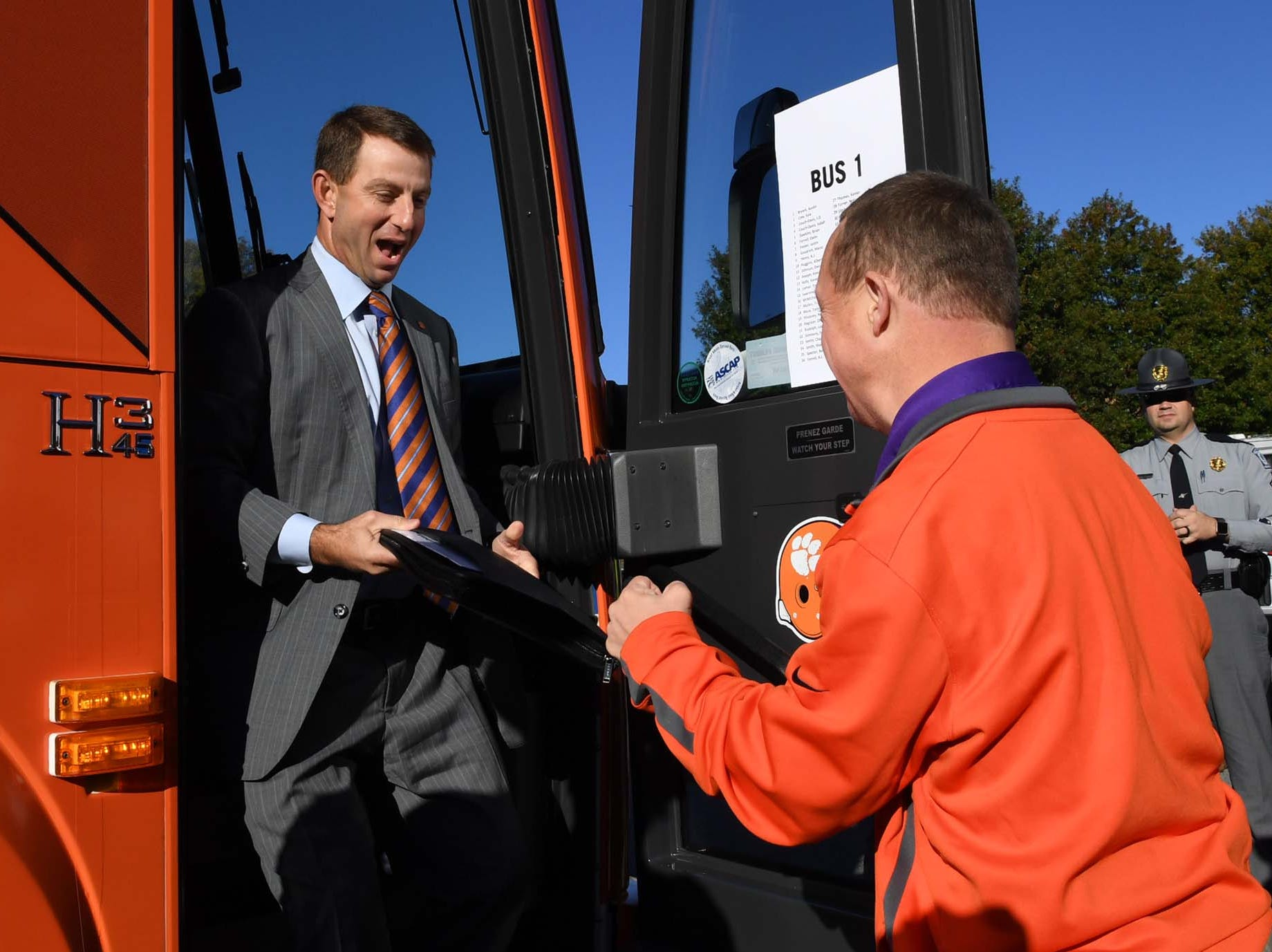 Clemson Head Coach Dabo Swinney is greeted by Brad Hammond during Tiger Walk before the game in Memorial Stadium on Saturday, November 3, 2018.