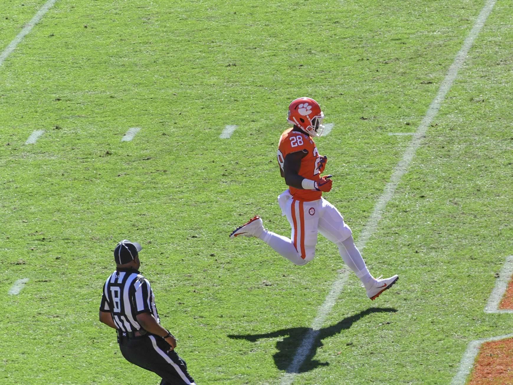 Clemson running back Tavien Feaster (28) runs a 70-yard touchdown against Louisville during the first quarter in Memorial Stadium on Saturday, November 3, 2018.