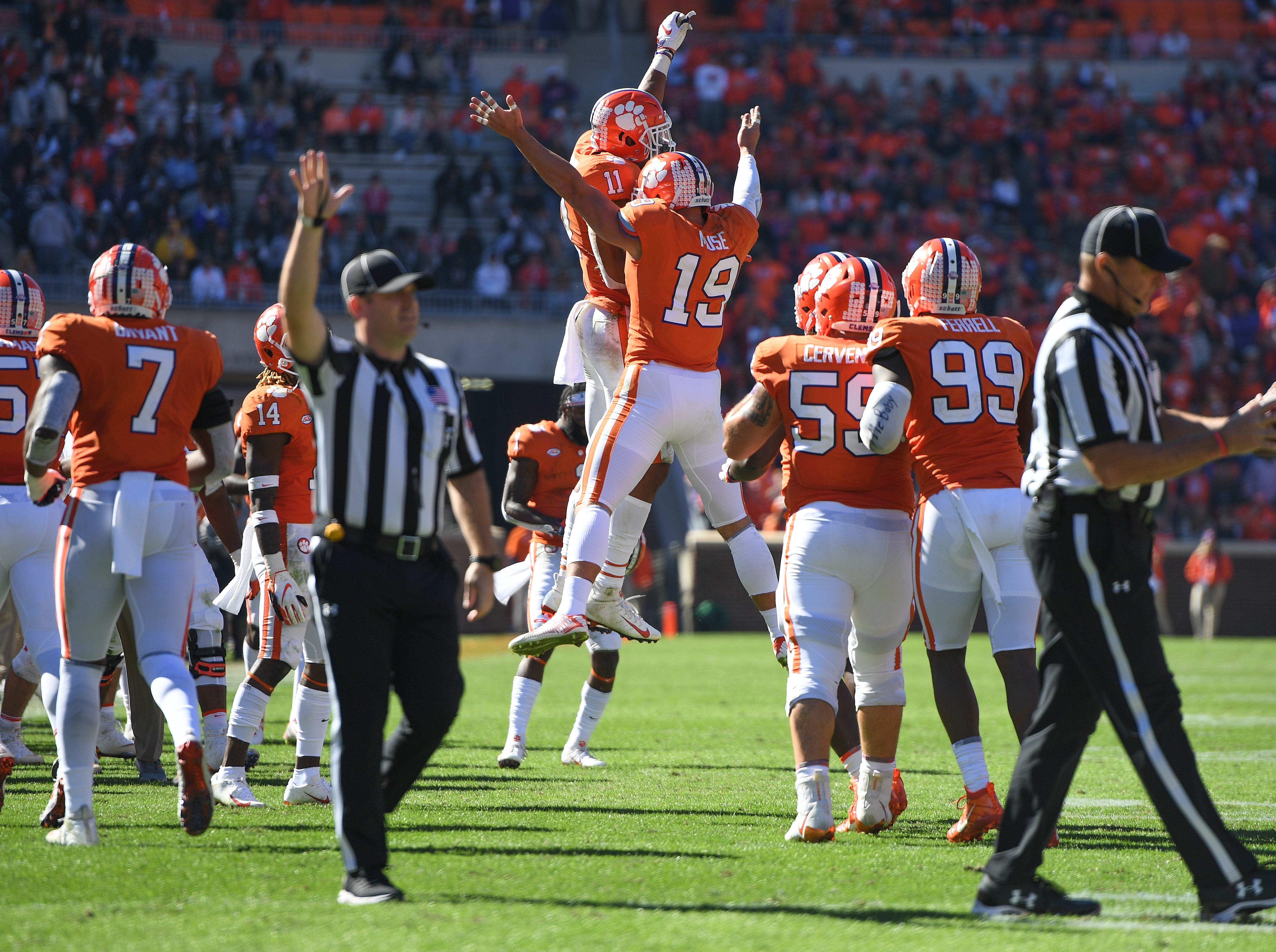 Clemson defensive back Tanner Muse (19) celebrates with safety Isaiah Simmons (11) after intercepting a Louisville pass during the 3rd quarter Saturday, November 3, 2018 at Clemson's Memorial Stadium.