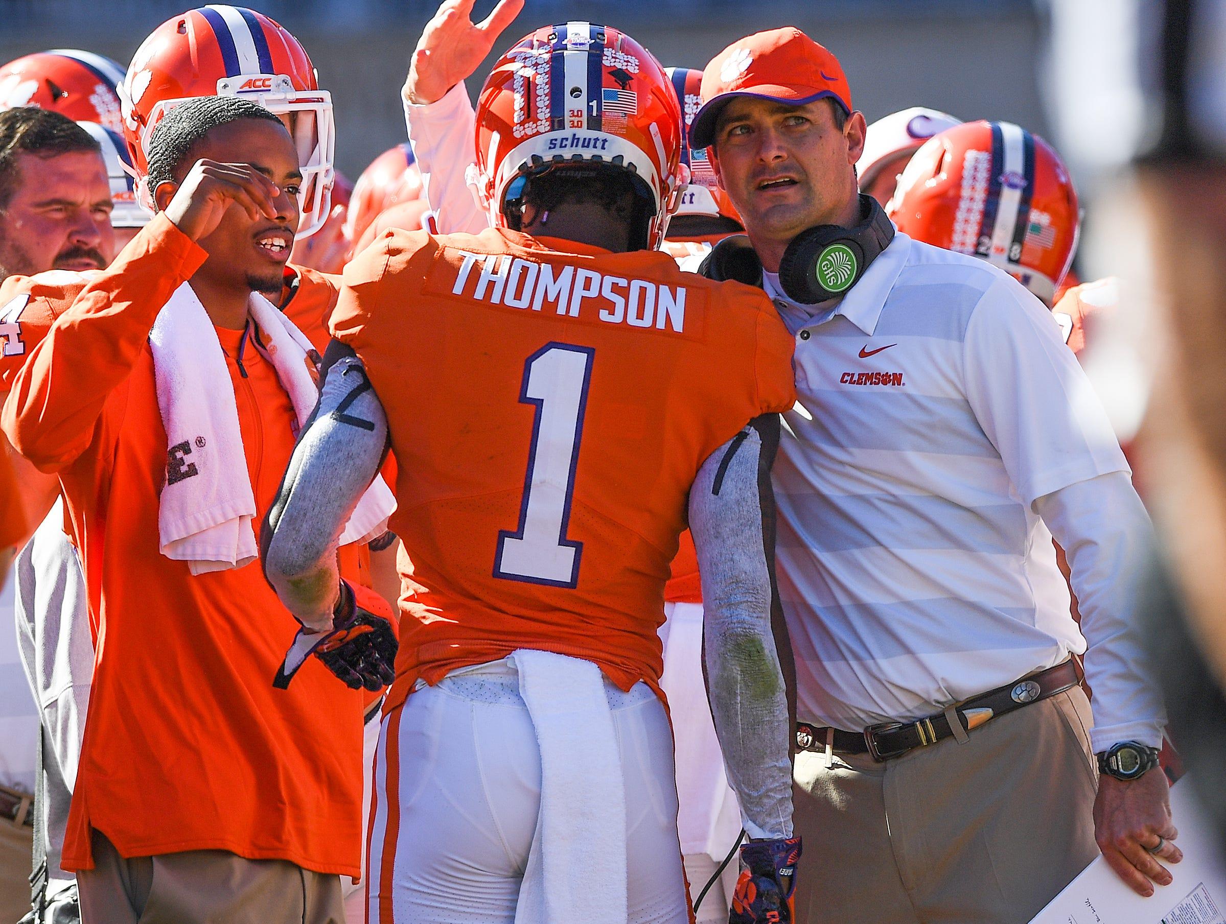 Clemson co-offensive coordinator Jeff Scott congratulates wide receiver Trevion Thompson (1) after a touchdown reception against Louisville during the 3rd quarter Saturday, November 3, 2018 at Clemson's Memorial Stadium.