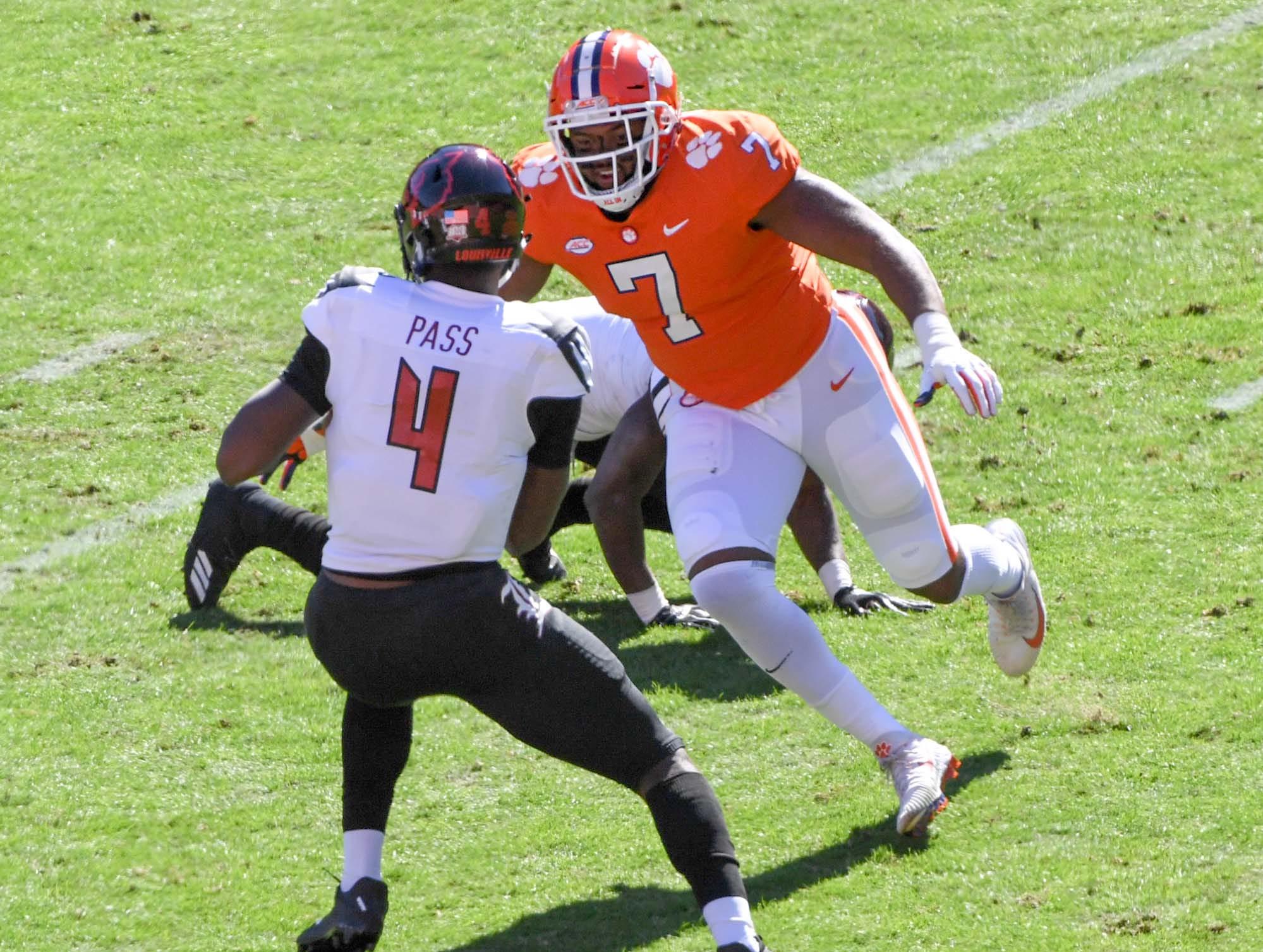 Clemson defensive lineman Austin Bryant (7) sacks Louisville quarterback Jawon Pass(4) during the first quarter in Memorial Stadium on Saturday, November 3, 2018.
