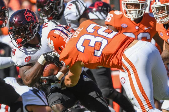 Louisville's Hassan Hall fights for yards Saturday against Clemson's defense.