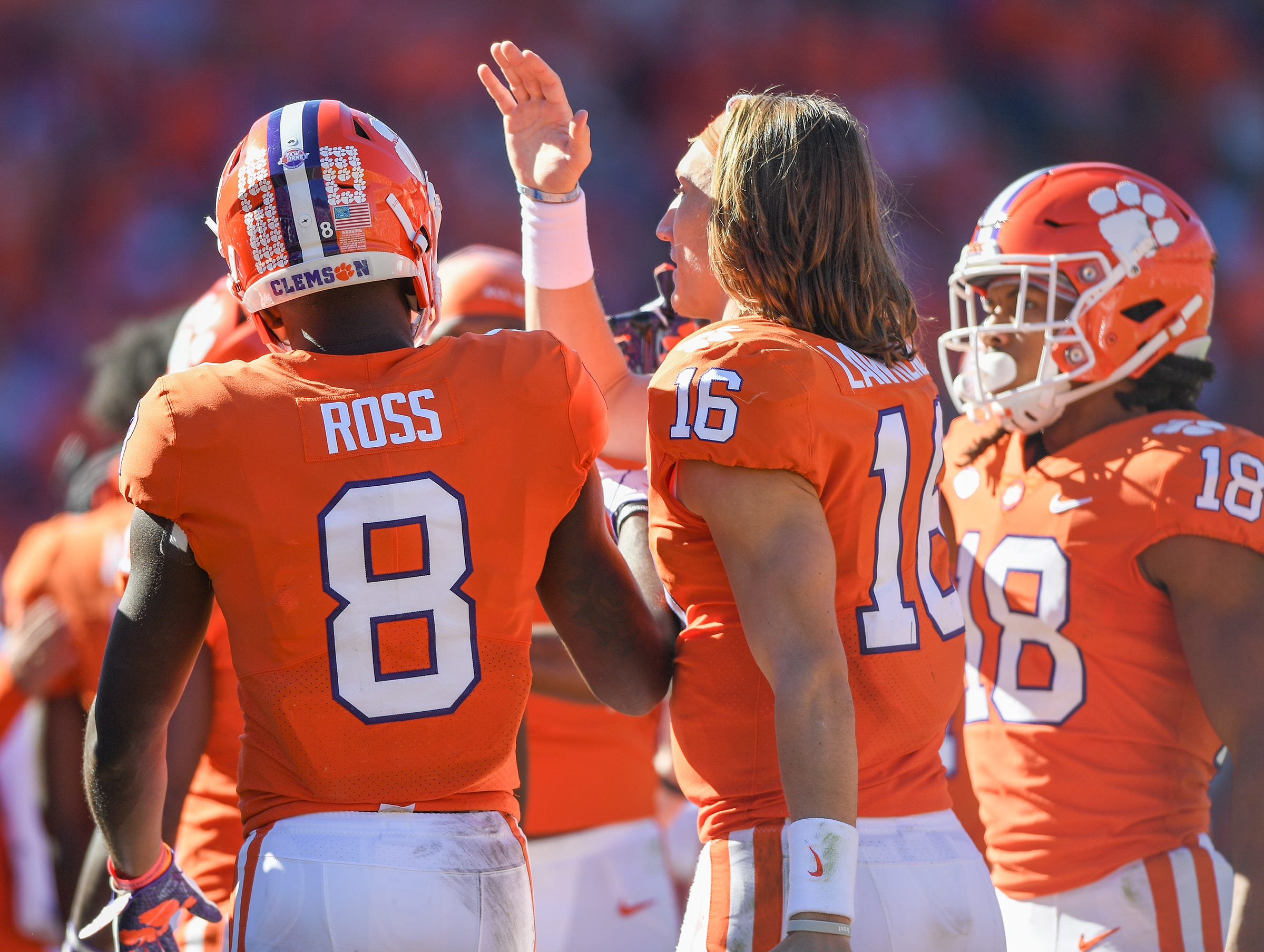 Clemson quarterback Trevor Lawrence (16) congratulates wide receiver Justyn Ross (8) after Ross caught a TD against Louisville during the 3rd quarter Saturday, November 3, 2018 at Clemson's Memorial Stadium.