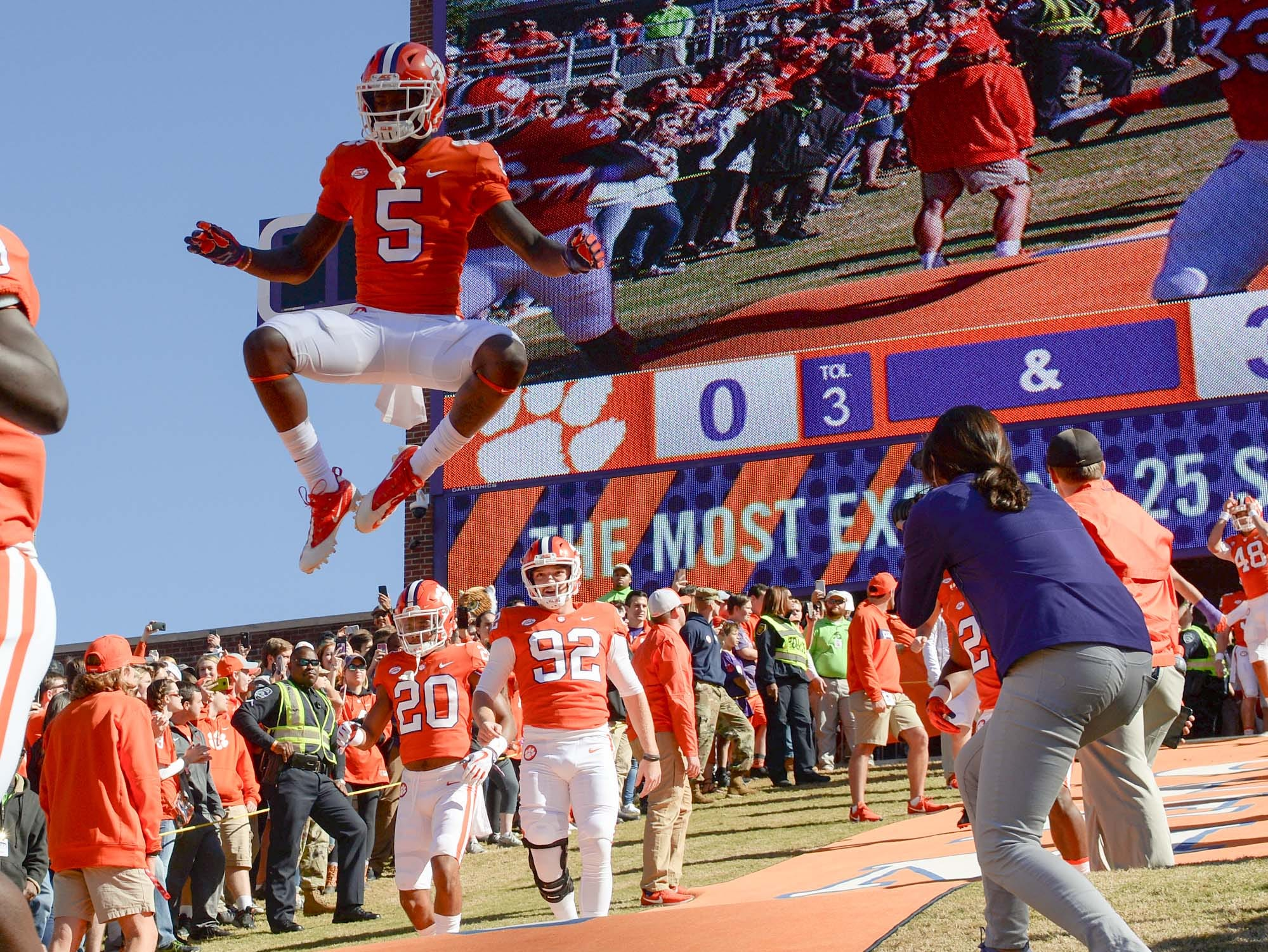 Clemson wide receiver Tee Higgins (5) leaps between running down the hill before the game with Louisville in Memorial Stadium on Saturday, November 3, 2018.