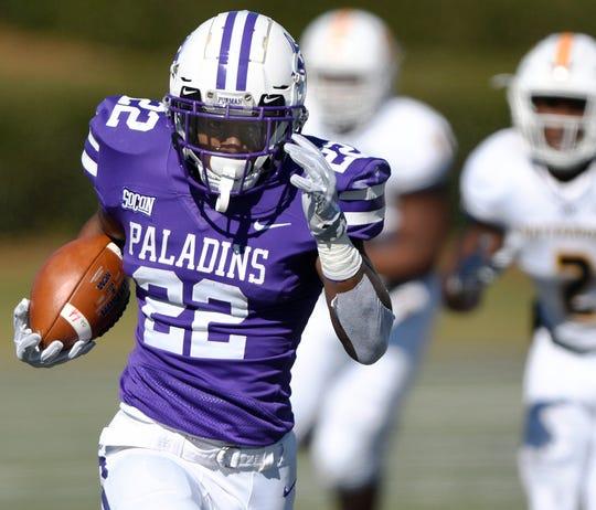 Furman tailback Devin Wynn (22) leaves Chattanooga on a 50 yard touchdown run Saturday, November 3, 2018, at Paladin Stadium.