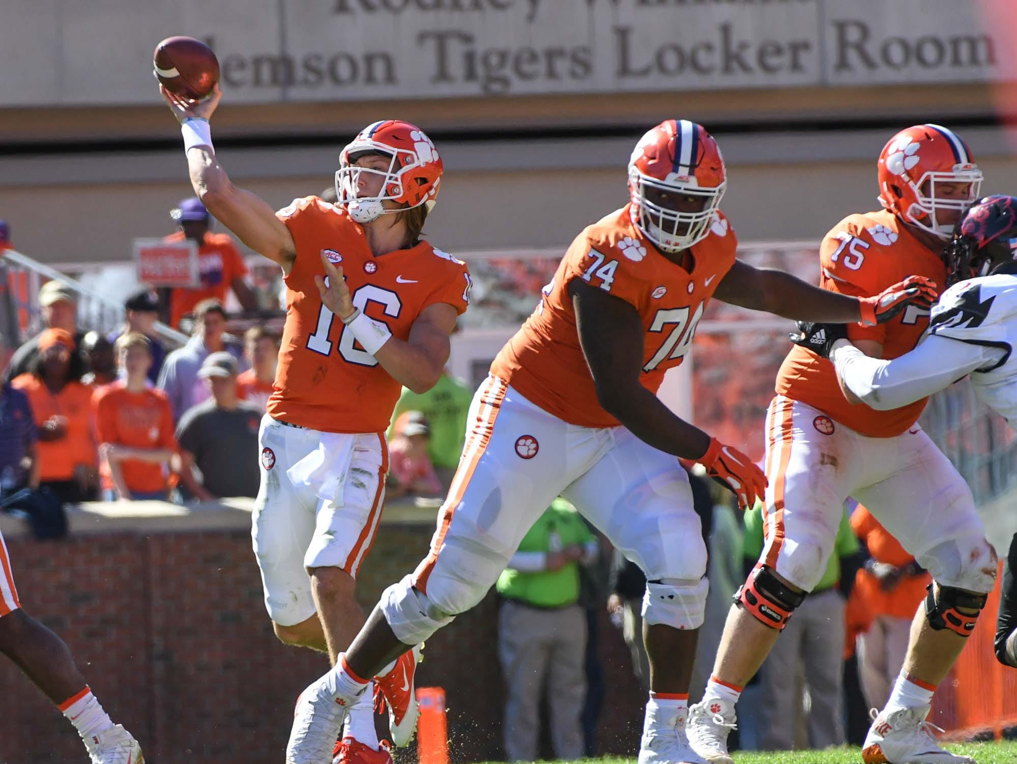 Clemson quarterback Trevor Lawrence (16) throws with blocking from offensive guard John Simpson (74) and offensive lineman Mitch Hyatt (75) during the second quarter in Memorial Stadium on Saturday, November 3, 2018.