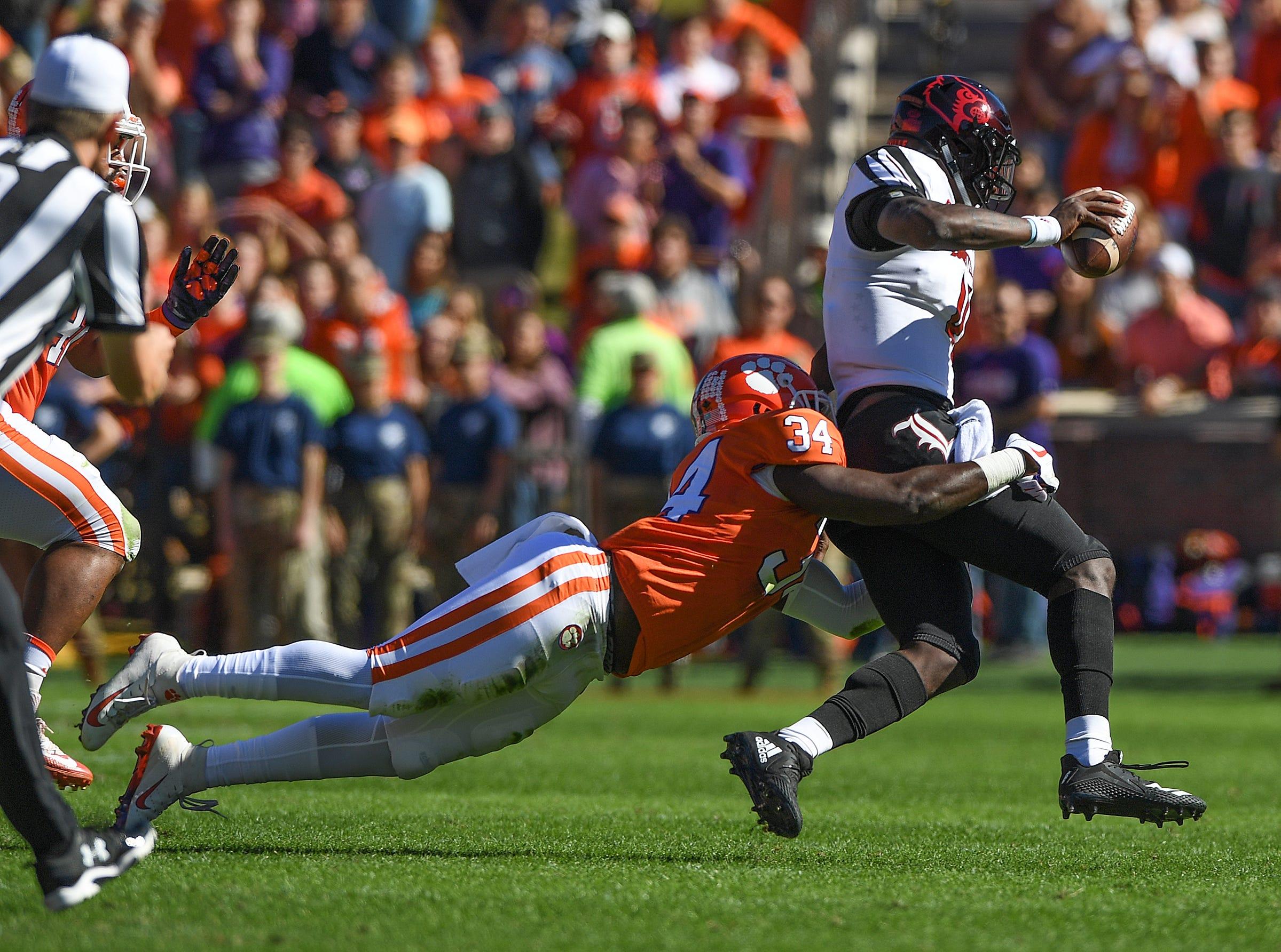 Clemson linebacker Kendall Joseph (34) brings down Louisville quarterback Jawon Pass (4) during the 1st quarter Saturday, November 3, 2018 at Clemson's Memorial Stadium.