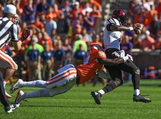 Clemson linebacker Kendall Joseph (34) brings down Louisville quarterback Jawon Pass (4) during the 1st quarter Saturday, November 3, 2018 at Clemson's Memorial Stadium.