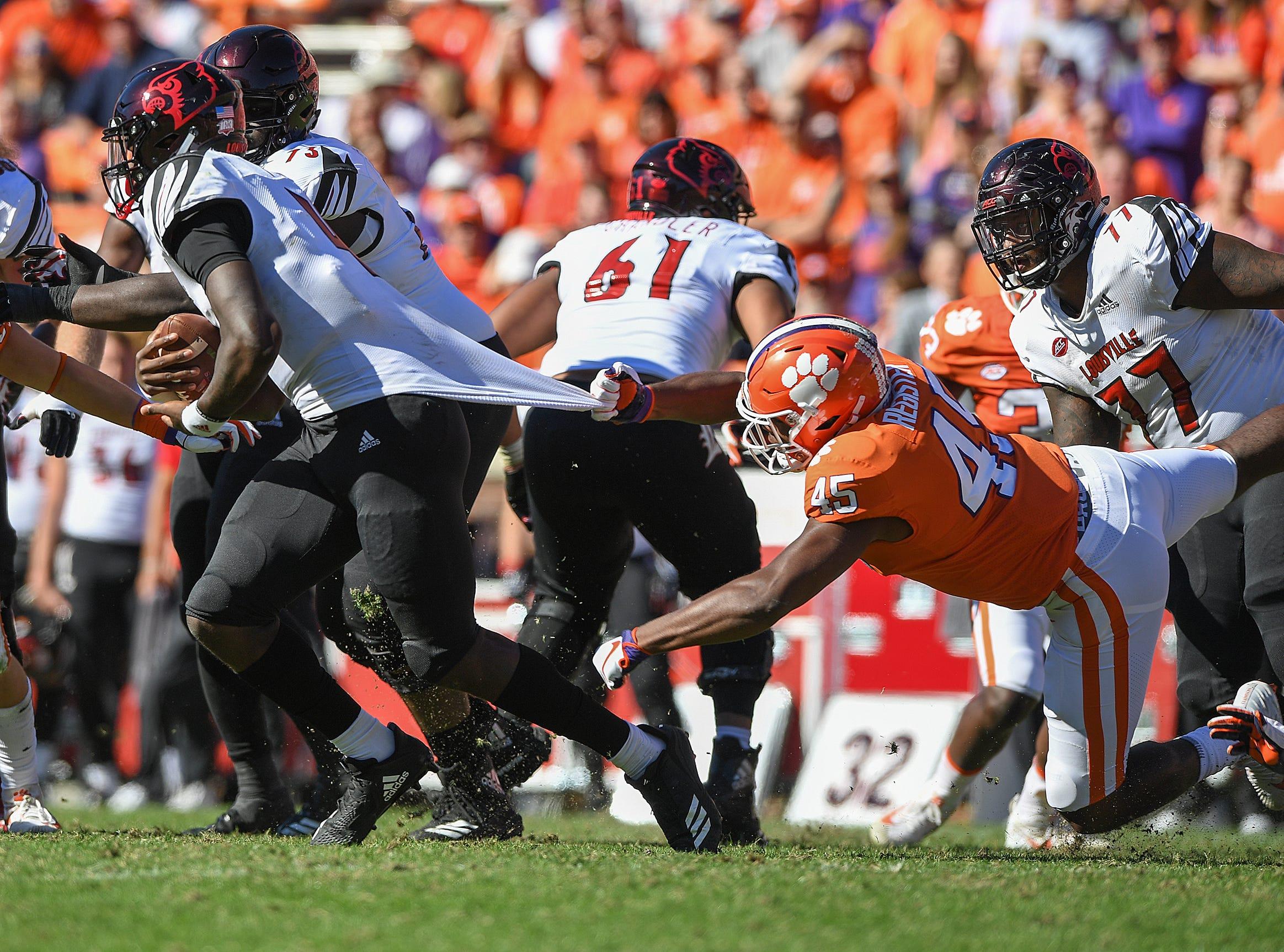 Clemson linebacker Chris Register (45) tries to stop Louisville quarterback Jawon Pass (4) during the 3rd quarter Saturday, November 3, 2018 at Clemson's Memorial Stadium.