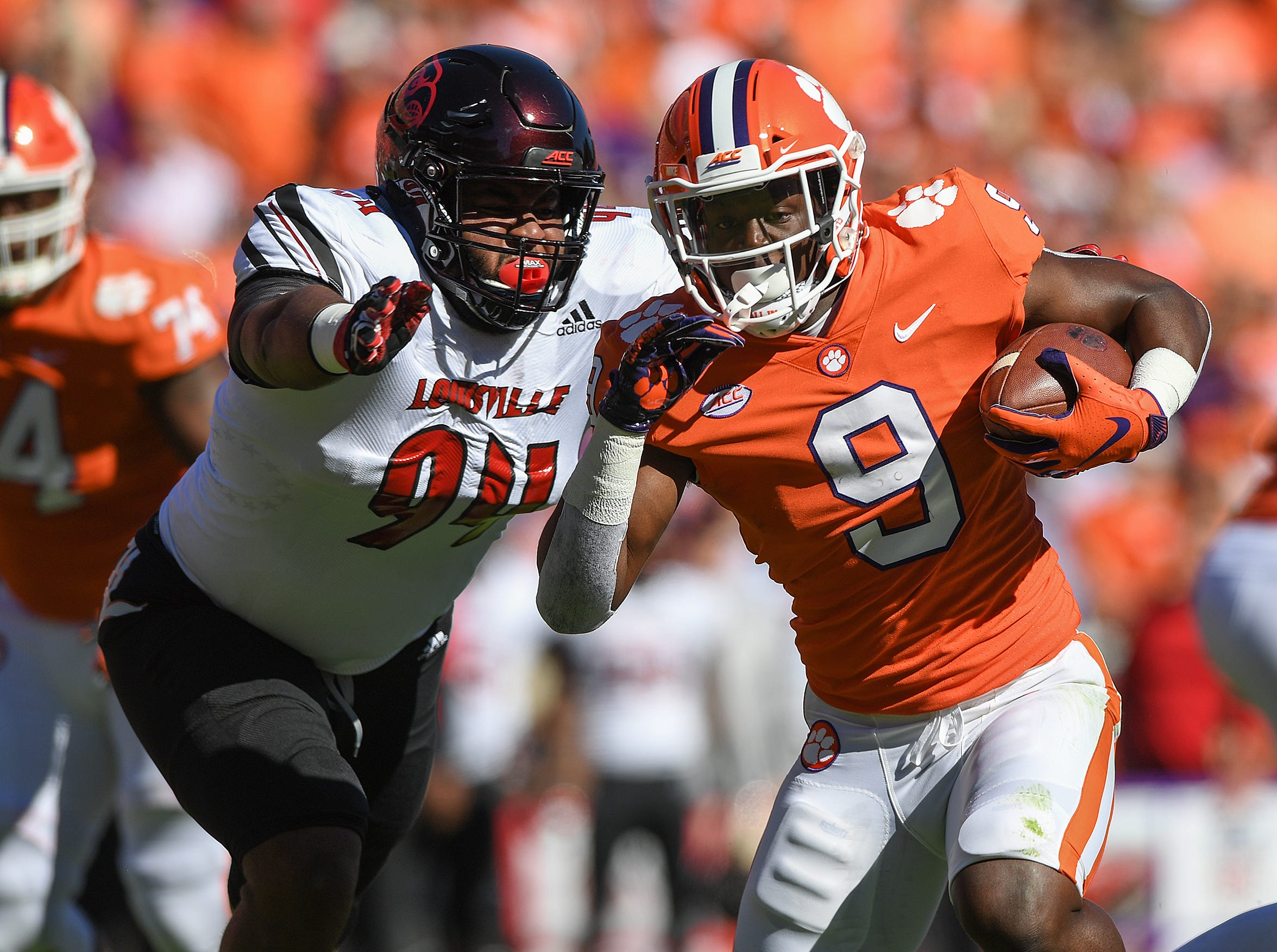 Clemson running back Travis Etienne (9) scores against Louisville during the 1st quarter Saturday, November 3, 2018 at Clemson's Memorial Stadium.