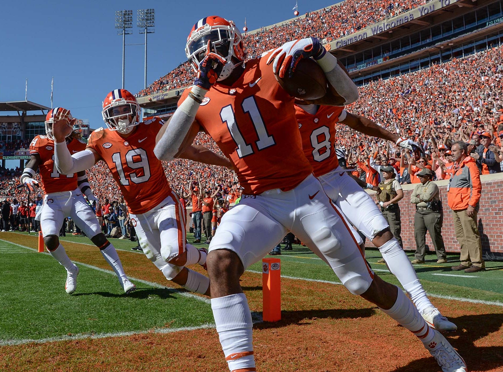 Clemson safety Isaiah Simmons (11) scores a touchdown after interception during the second quarter in Memorial Stadium on Saturday, November 3, 2018.