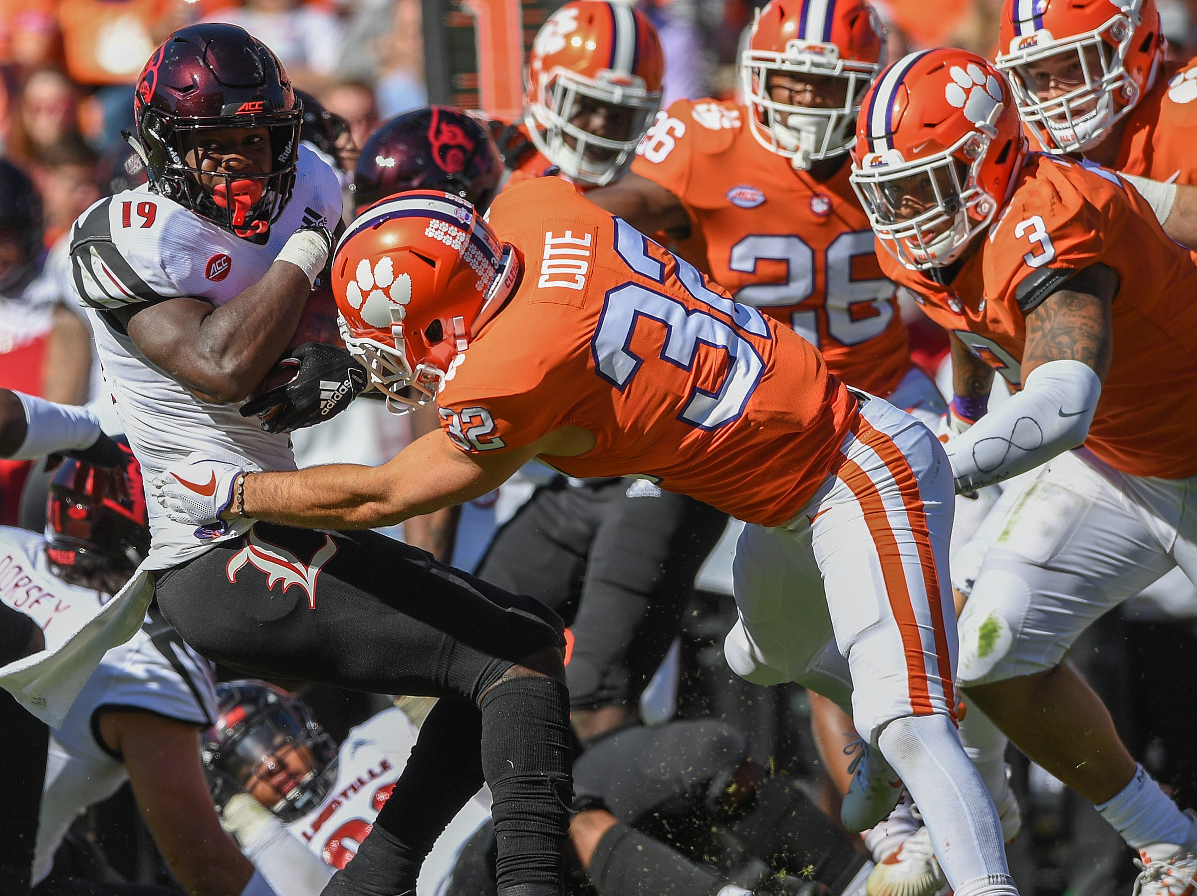Clemson safety Kyle Cote (32) brings down Louisville running back Hassan Hall (19) during the 3rd quarter Saturday, November 3, 2018 at Clemson's Memorial Stadium.
