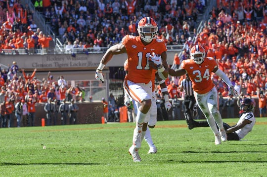 Clemson safety Isaiah Simmons (11) returns an interception for a touchdown agains Louisville during the second quarter in Memorial Stadium on Saturday, November 3, 2018.