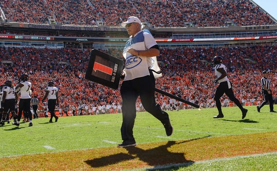 Ron Mitchell carries a down marker between plays with Louisville and Clemson during the first quarter in Memorial Stadium on Saturday, November 3, 2018.