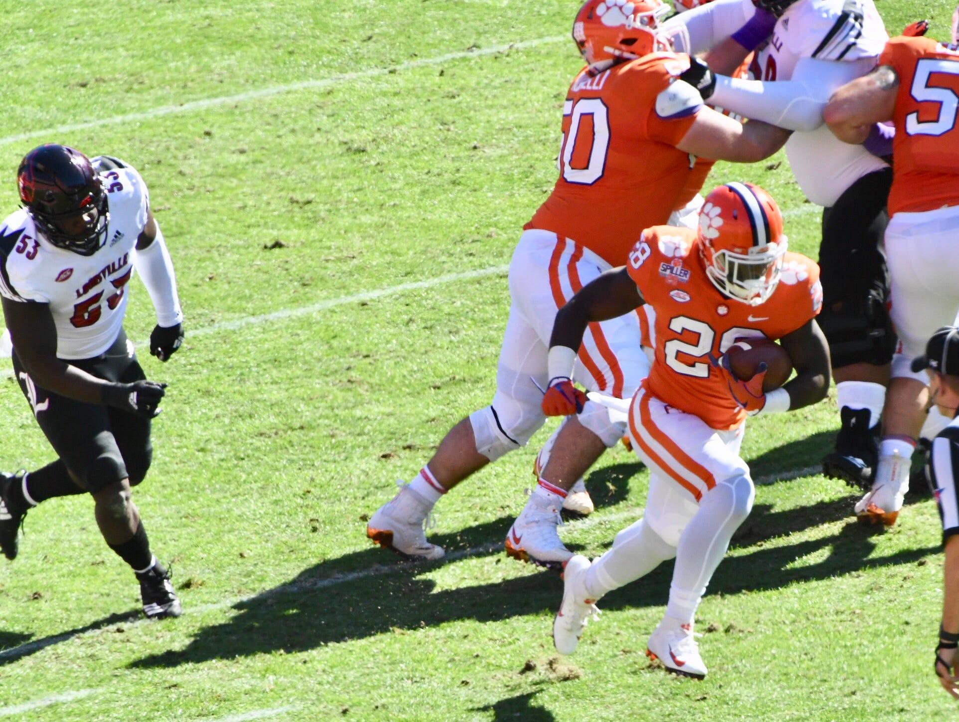 Clemson's Tevin Feaster breaks through for a 70-yard touchdown against Louisville.