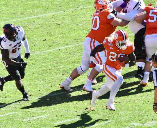 Clemson's Tevin Feaster breaks through for a 70-yard touchdown against Louisville.