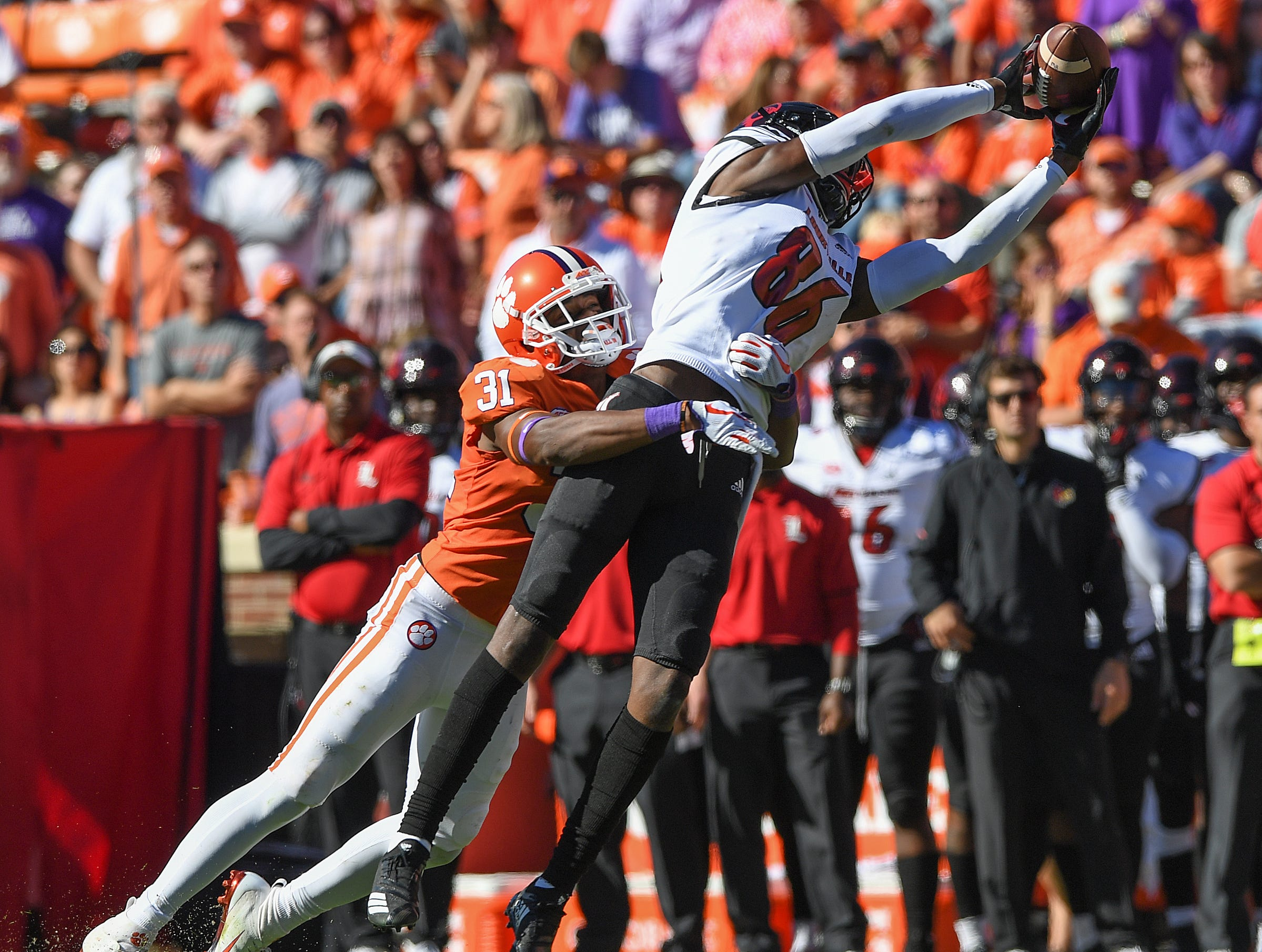 Clemson tight end Cole Renfrow (31) defends Louisville wide receiver Devante Peete (86) during the 3rd quarter Saturday, November 3, 2018 at Clemson's Memorial Stadium.