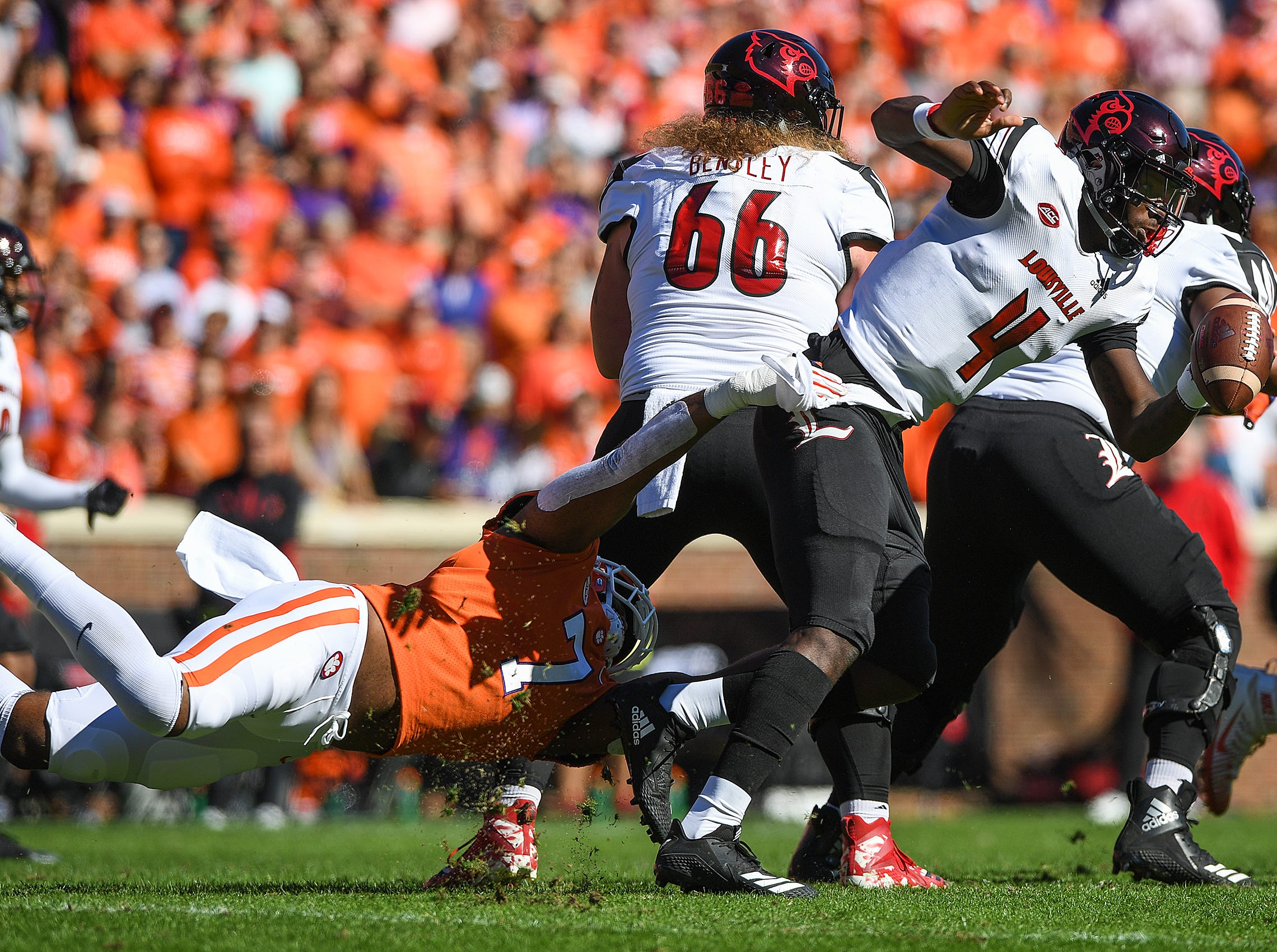 Clemson defensive lineman Austin Bryant (7) sacks Louisville quarterback Jawon Pass (4) during the 1st quarter Saturday, November 3, 2018 at Clemson's Memorial Stadium.