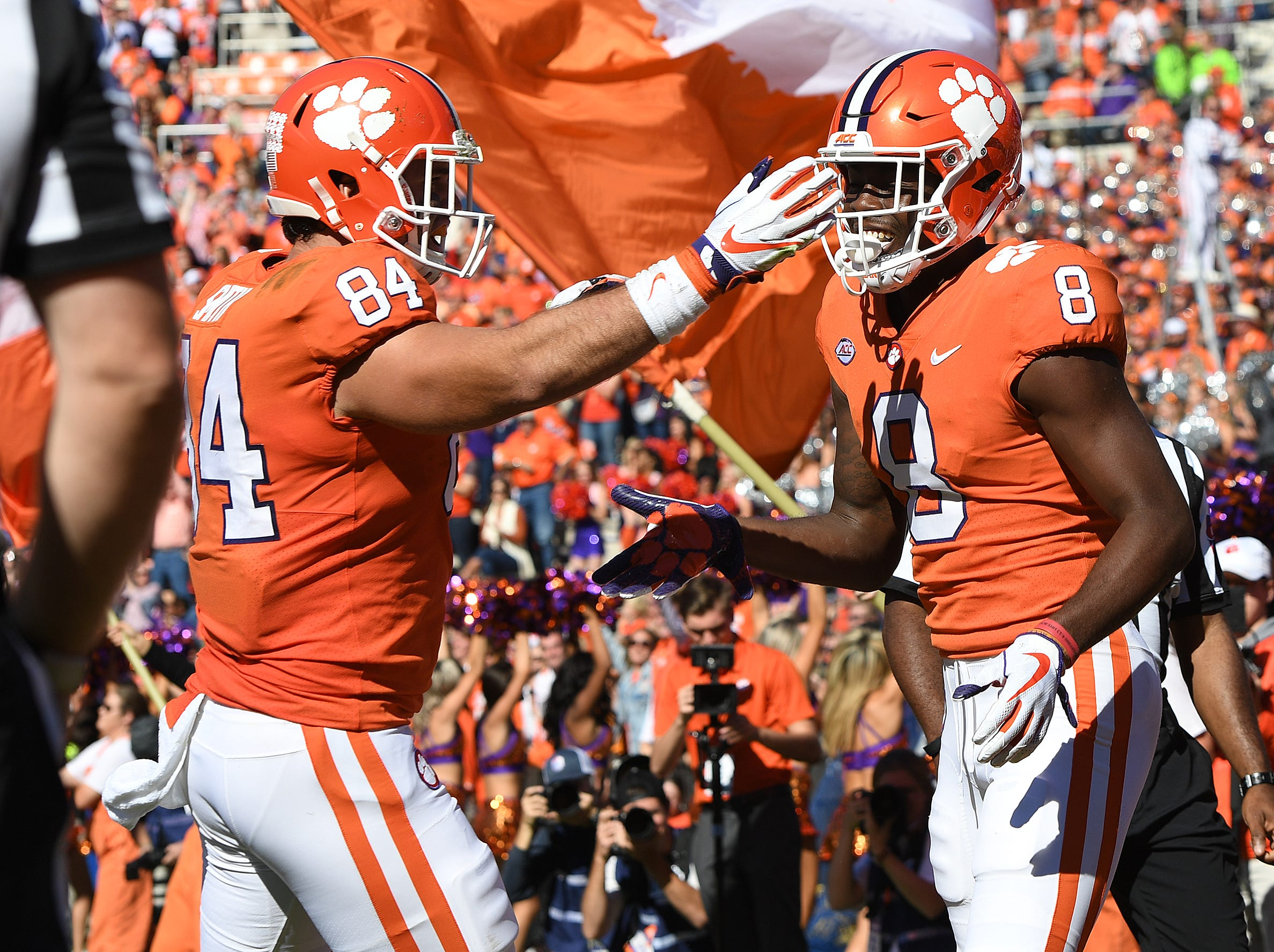 Clemson wide receiver Justyn Ross (8) celebrates with tight end Cannon Smith (84) after scoring against Louisville during the 3rd quarter Saturday, November 3, 2018 at Clemson's Memorial Stadium.