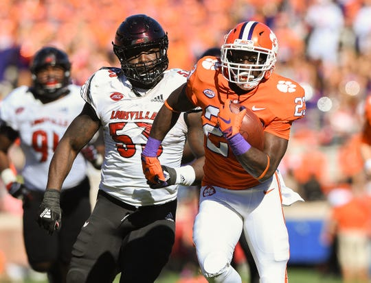 Clemson running back Lyn-J Dixon (23) breaks free to score against Louisville during the 4th quarter Saturday, November 3, 2018 at Clemson's Memorial Stadium.
