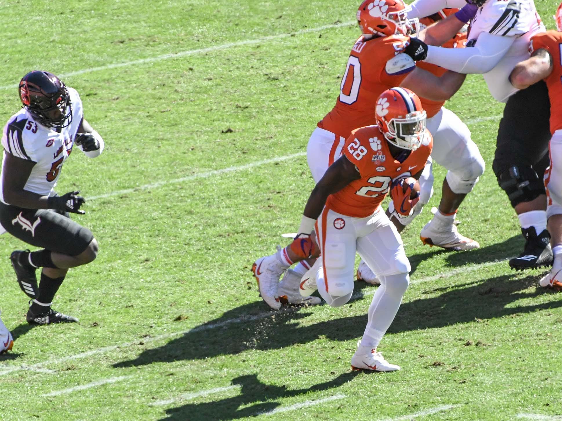 Clemson running back Tavien Feaster (28) runs for a 70-yard touchdown during the first quarter in Memorial Stadium on Saturday, November 3, 2018.