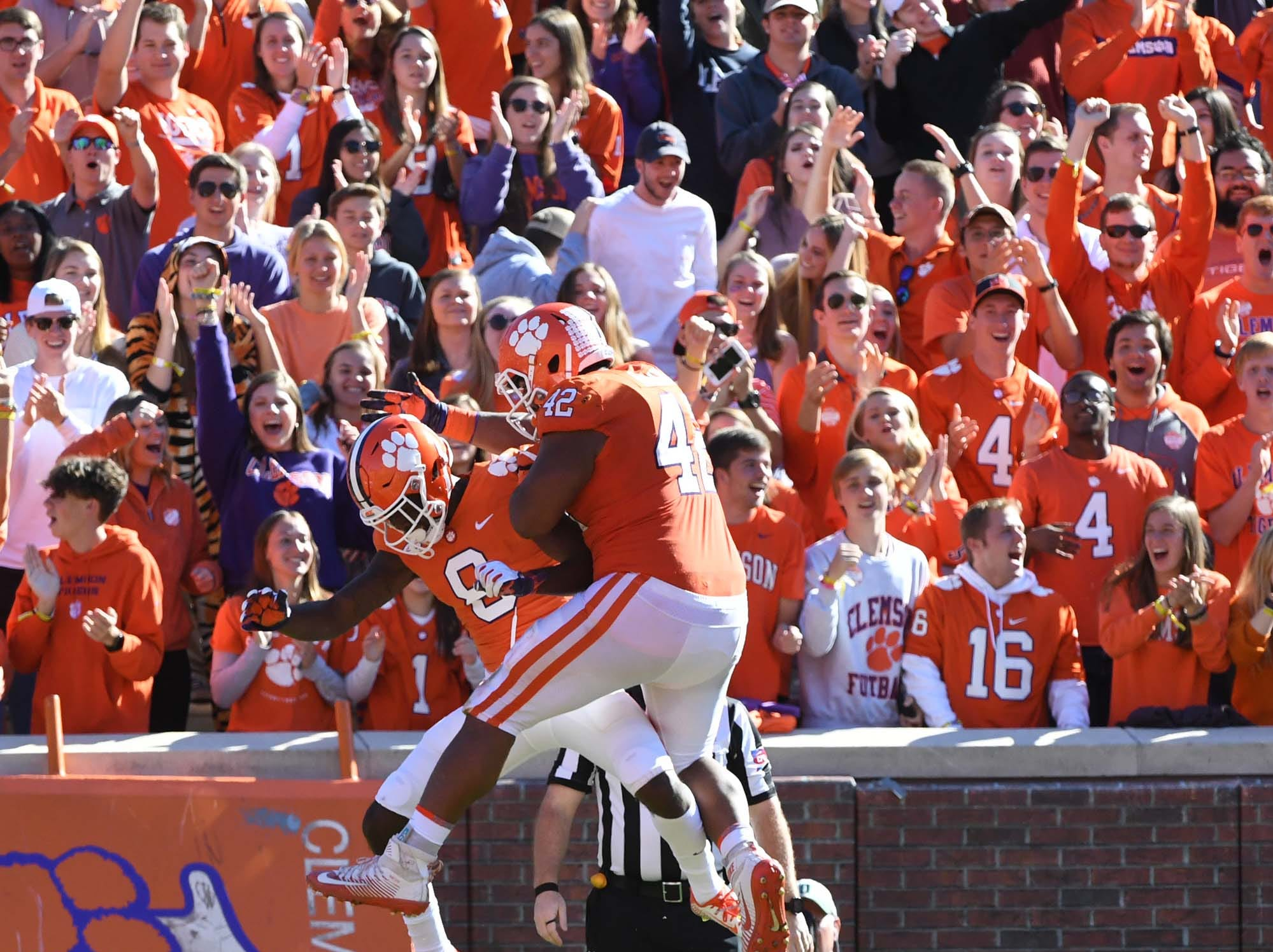 Clemson wide receiver Justyn Ross (8) celebrates a 59-yard touchdown with defensive lineman Christian Wilkins (42) during the third quarter in Memorial Stadium on Saturday, November 3, 2018.