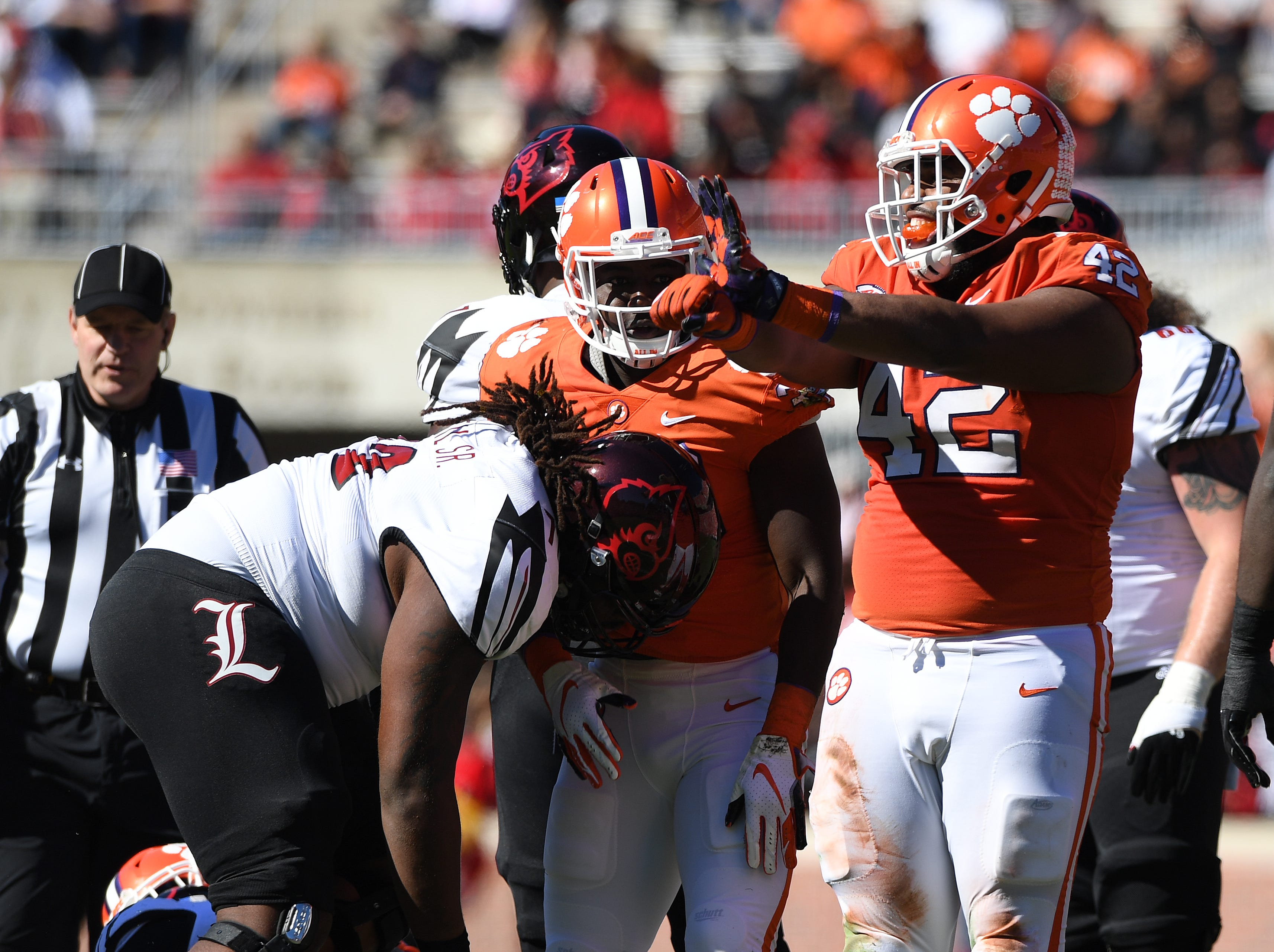 Clemson defensive lineman Christian Wilkins (42) reacts after a defensive stop against Louisville during the 2nd quarter Saturday, November 3, 2018 at Clemson's Memorial Stadium.