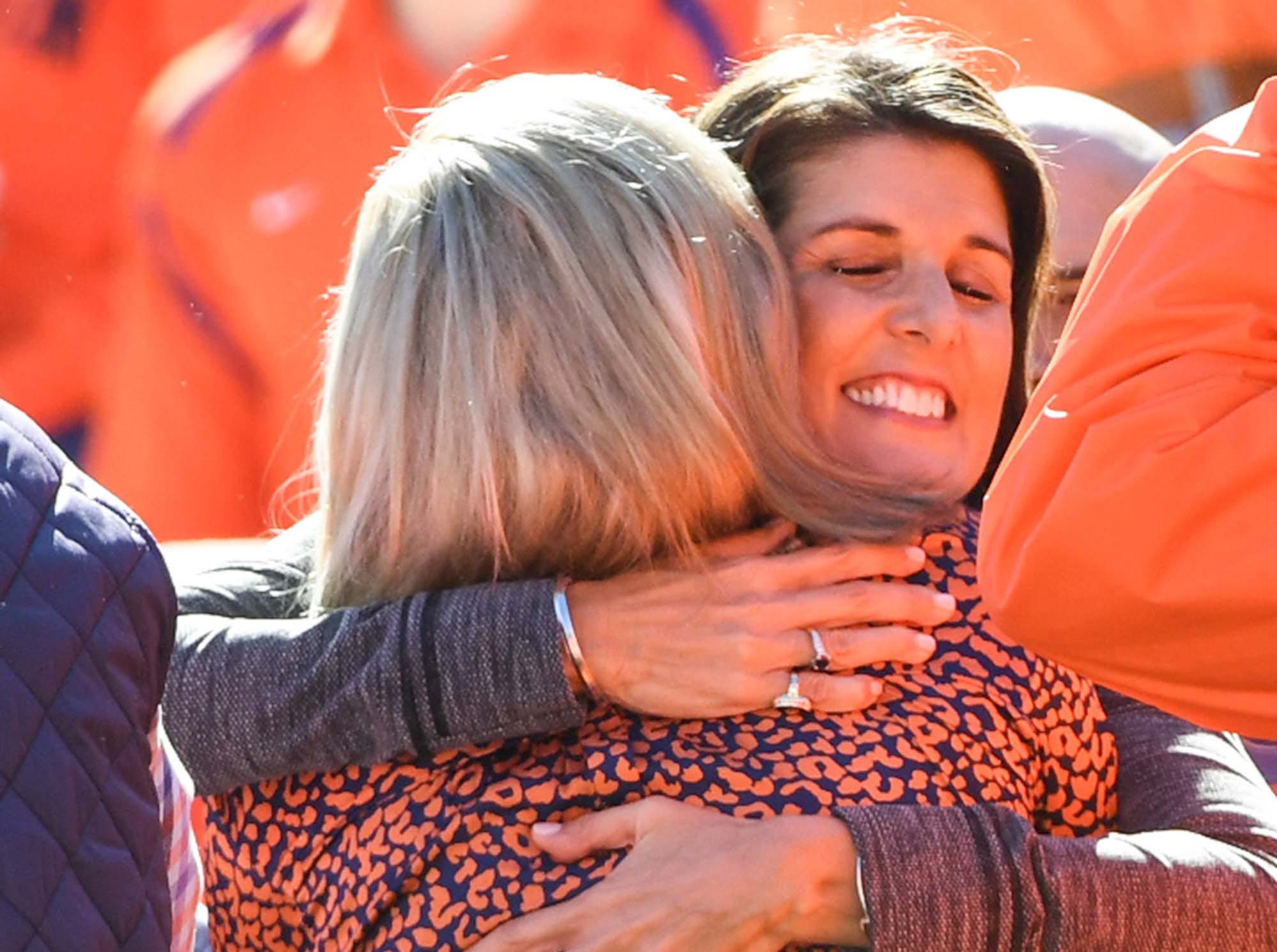 Former State Governor Nikki Haley hugs Beth Clements before the game in Memorial Stadium on Saturday, November 3, 2018.