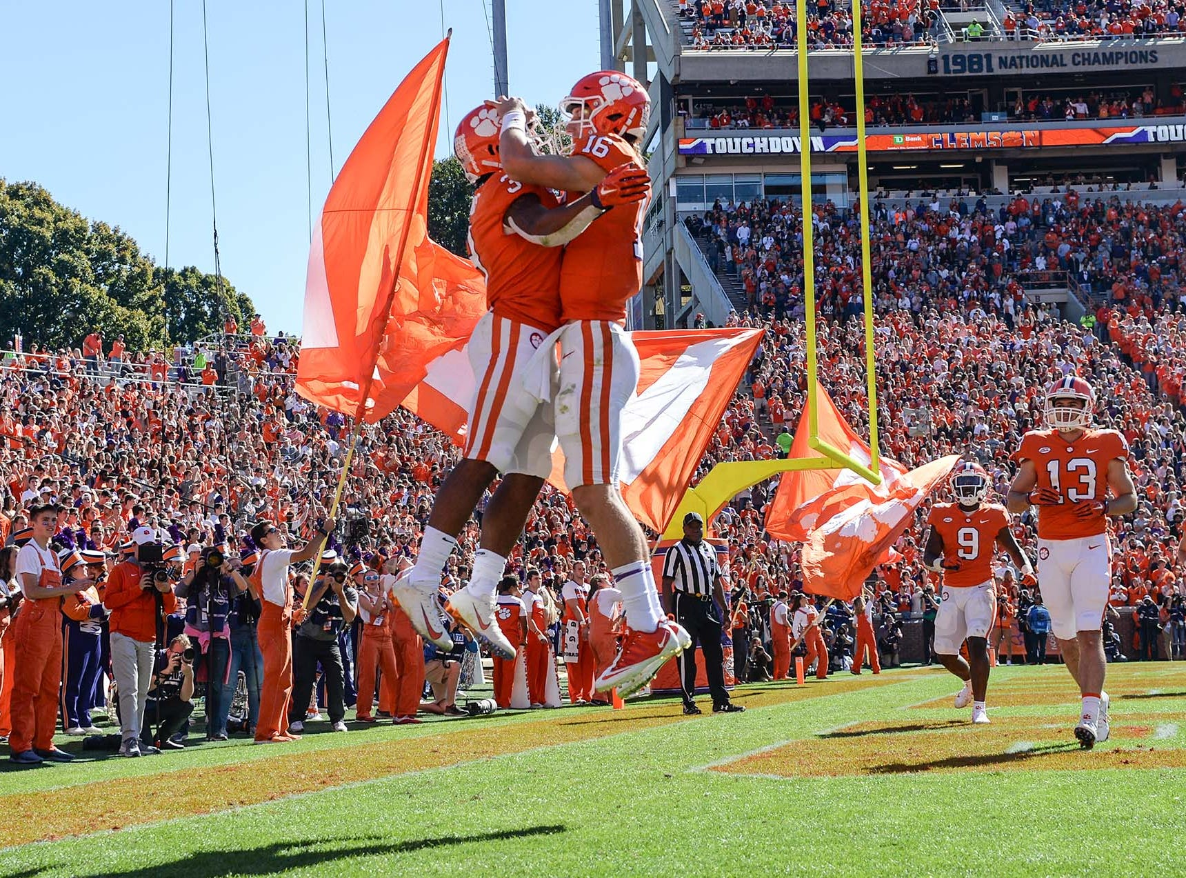 Clemson quarterback Trevor Lawrence (16) congratulates wide receiver Amari Rodgers (3) after his touchdown during the second quarter in Memorial Stadium on Saturday, November 3, 2018.