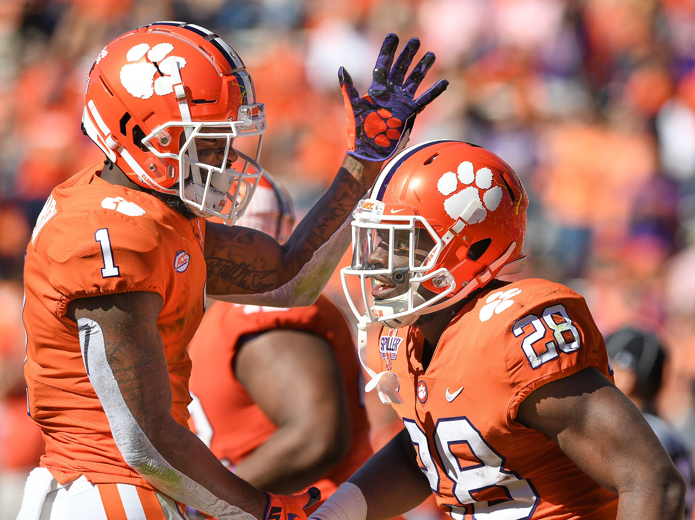 Clemson wide receiver Trevion Thompson (1) celebrates with running back Tavien Feaster (28) after Feaster scored against Louisville during the 3rd quarter Saturday, November 3, 2018 at Clemson's Memorial Stadium.