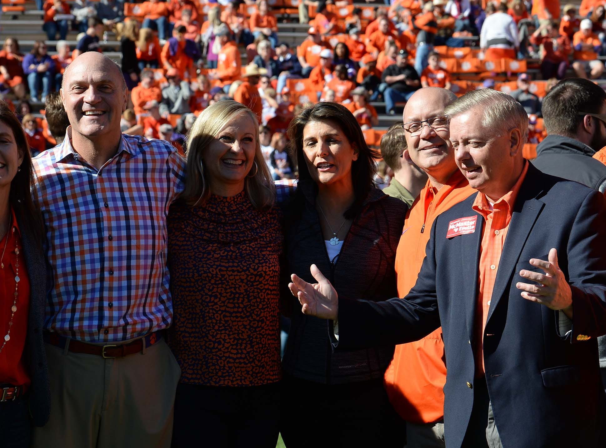 Clemson President Jim Clements, left, Beth Clements, former State Gov. Nikie Haley, look at U.S. Sen. Lindsey Graham, right, before the game in Memorial Stadium on Saturday, November 3, 2018.