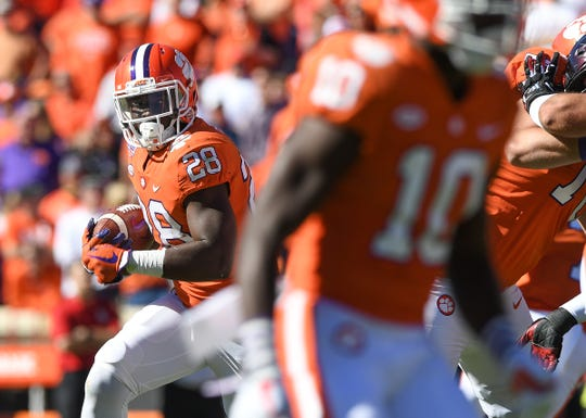 Clemson running back Tavien Feaster (28) carries against Louisville during the 3rd quarter Saturday, November 3, 2018 at Clemson's Memorial Stadium.