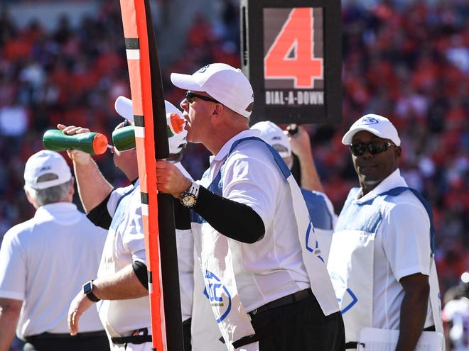 Brian Tillotson, working with the chain crew on the sidelines, carries a marker pole during the Clemson and Louisville football game action in the fourth quarter in Memorial Stadium on Saturday, November 3, 2018.