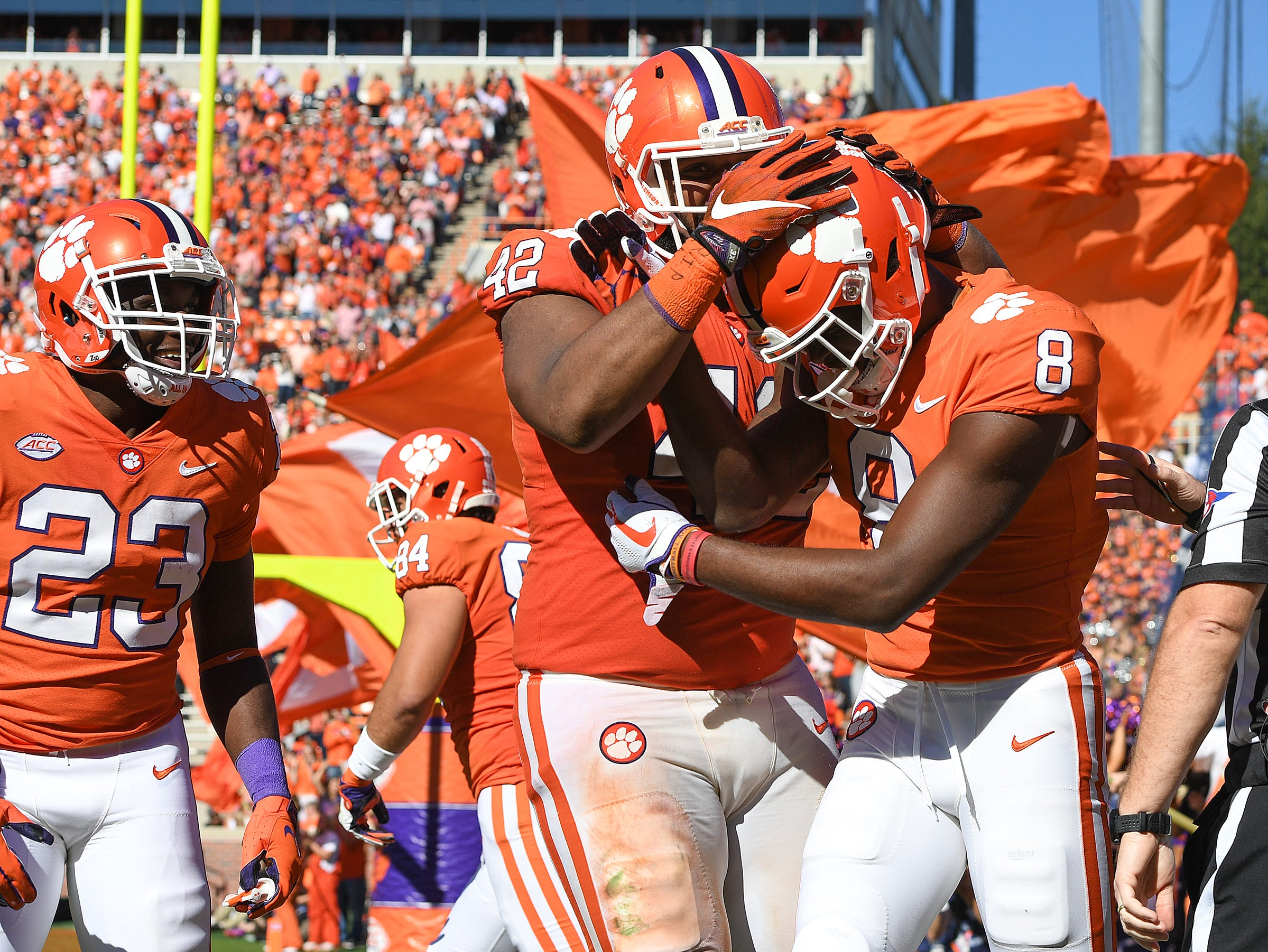 Clemson wide receiver Justyn Ross (8) celebrates with defensive lineman Christian Wilkins (42) after scoring against Louisville during the 3rd quarter Saturday, November 3, 2018 at Clemson's Memorial Stadium.