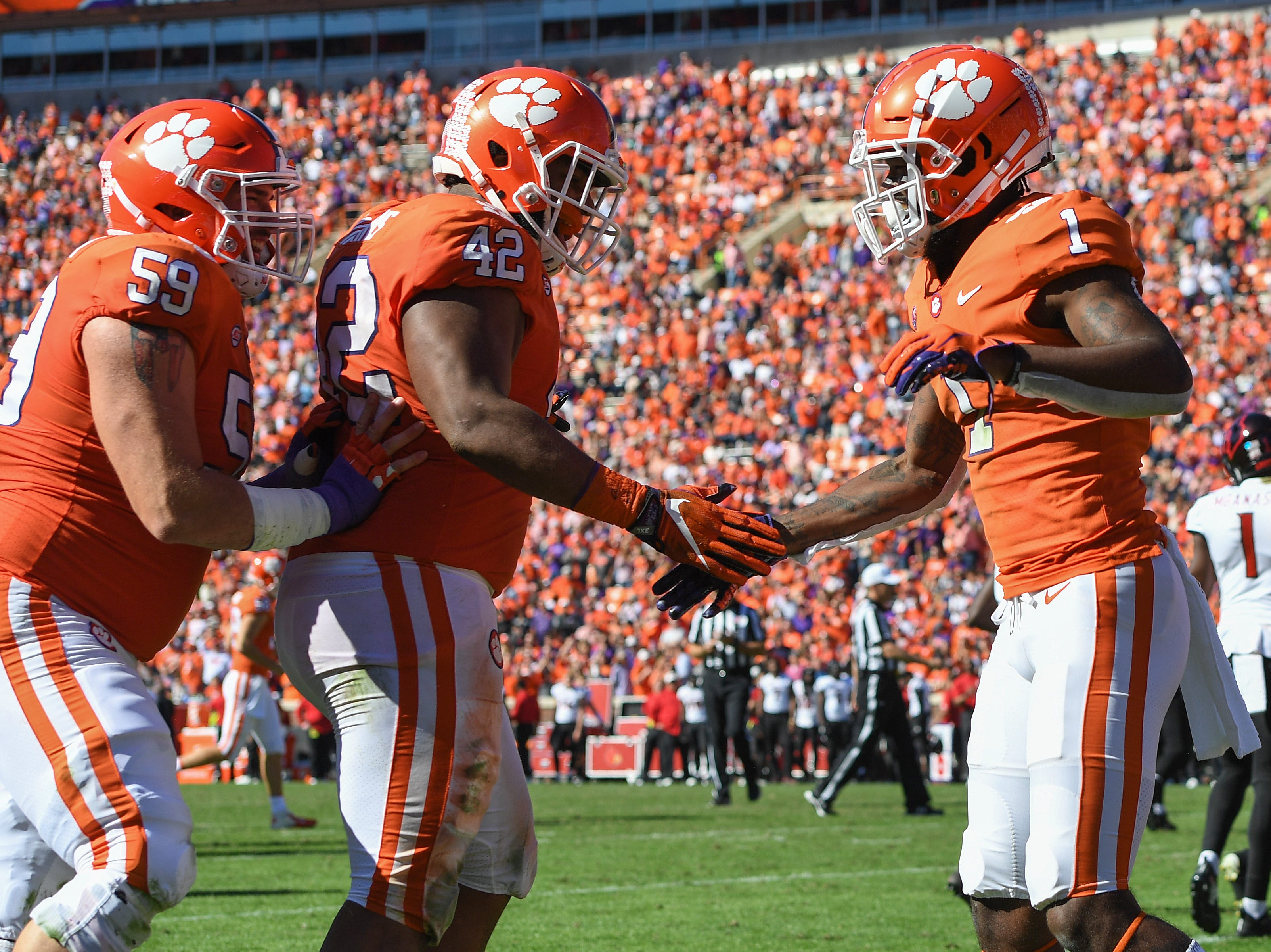 Clemson wide receiver Trevion Thompson (1) celebrates  defensive lineman Christian Wilkins (42) after catching a TD against Louisville during the 3rd quarter Saturday, November 3, 2018 at Clemson's Memorial Stadium.