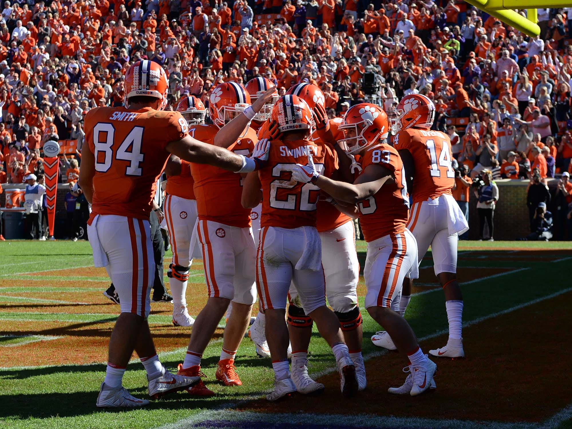 Clemson wide receiver Will Swinney (22) is congratulated by teammates after scoring his first college level touchdown against Louisville during the fourth quarter in Memorial Stadium on Saturday, November 3, 2018.