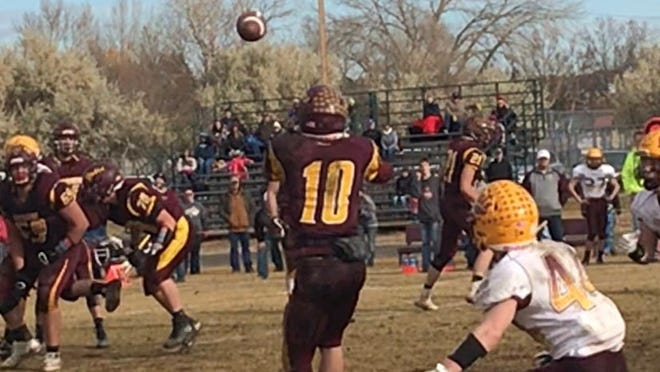 Shelby's Wyatt Brusven (10) catches a short pass in from of Circle's Trey Taylor (44) in the fourth quarter of the Coyotes' 59-42 second-round win over the Wildcats Saturday in Shelby.