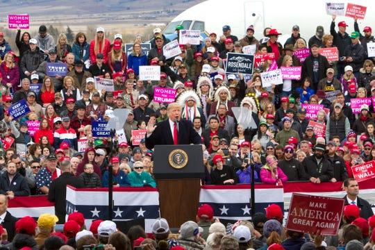 President Donald Trump speaks during a campaign rally at Bozeman Yellowstone International Airport, Saturday, Nov. 3, 2018, in Belgrade, Mont. (AP Photo/Janie Osborne)
