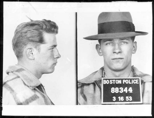 """This 1953 Boston police booking photo shows James """"Whitey"""" Bulger after an arrest. Bulger and his girlfriend Catherine Greig, were apprehended Thursday, June 23, 2001, in Santa Monica, Calif., after 16 years on the run. Opening statements in his trial were made in U.S. District Court in Boston Wednesday, June 12, 2013. (Boston Police via AP)"""