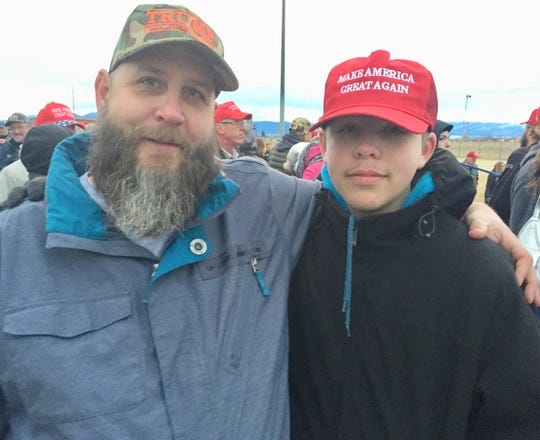Jon Musson and son Bailey, 14, came Friday night to get in line for Saturday's Trump rally in Belgrade.