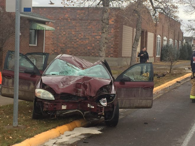 A car knocked down a power pole, a fire hydrant and some street signs in a Saturday morning crash near Gibson Park.