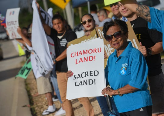 Local organizations and their supporters gathered across the Naval Communications Station gate in Dededo to protest against the military's removal of ancient Chamoru village, Magua, in South Finegayan, the site for the new Marine Base, Nov. 3, 2018.