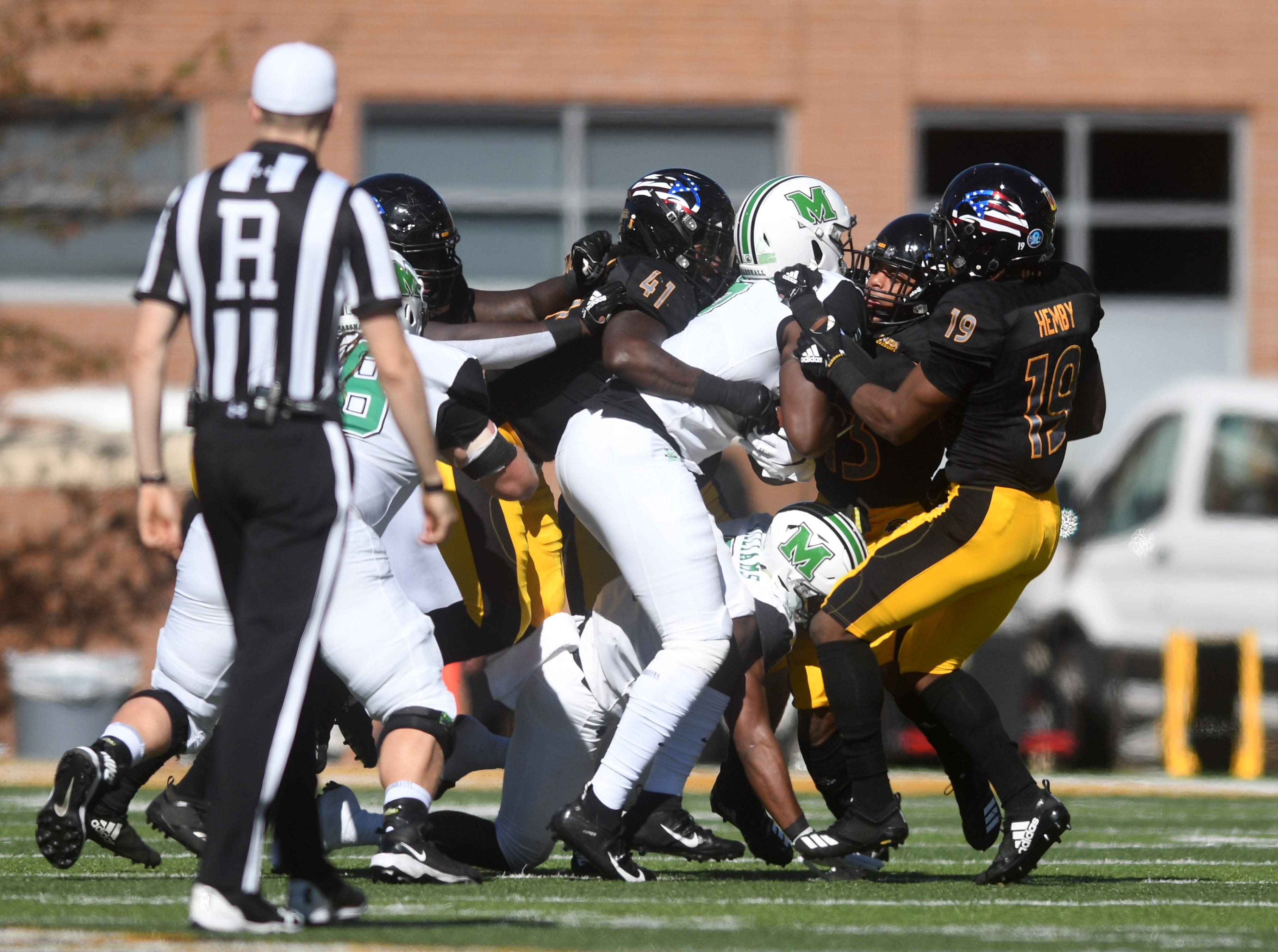 Southern Miss defensives players make a stop in a game against Marshall at M.M. Roberts Stadium on Saturday, November 3, 2018.
