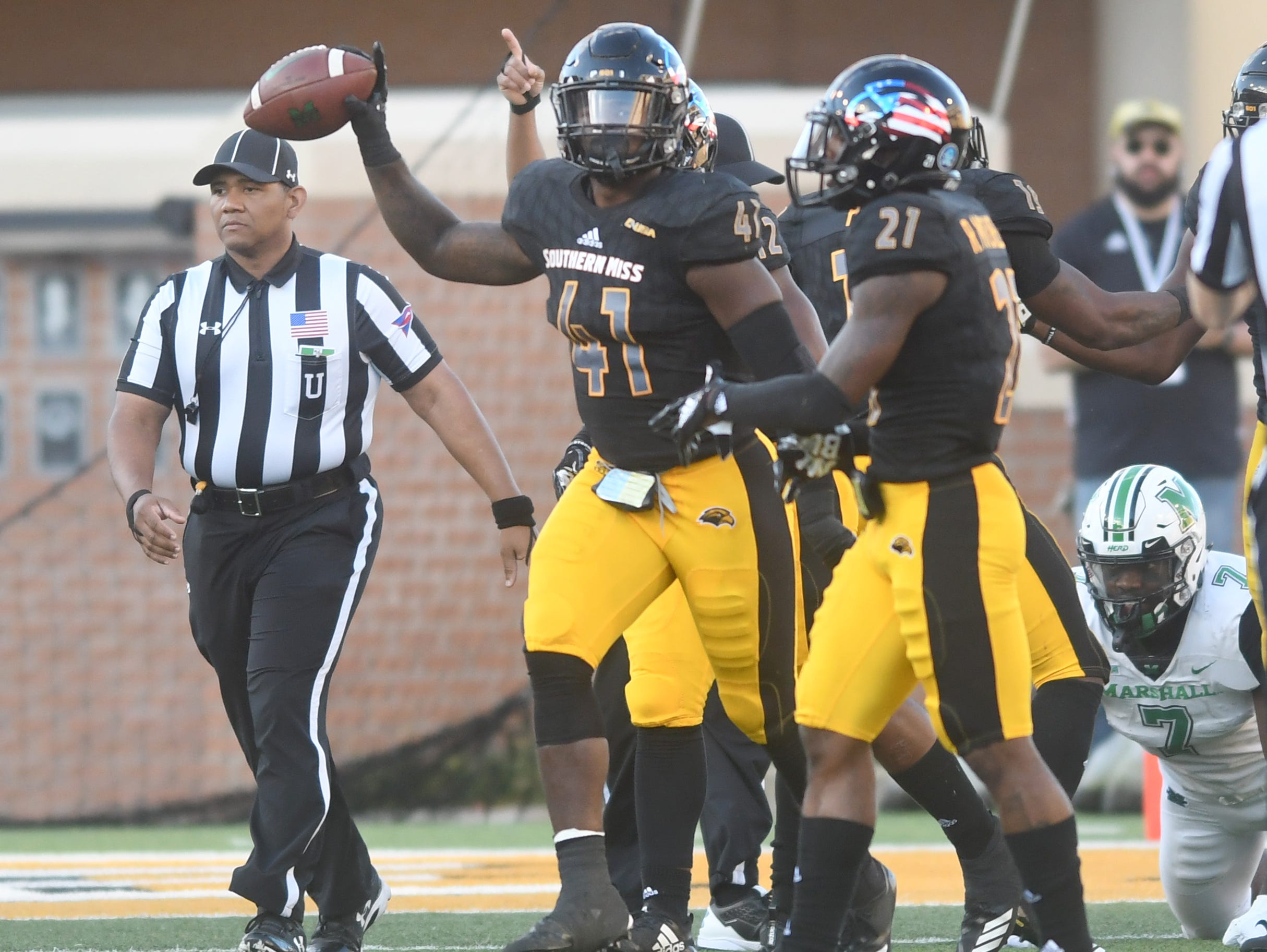 Southern Miss linebacker Racheem Boothe recovers a fumble in a game against Marshall at M.M. Roberts Stadium on Saturday, November 3, 2018.