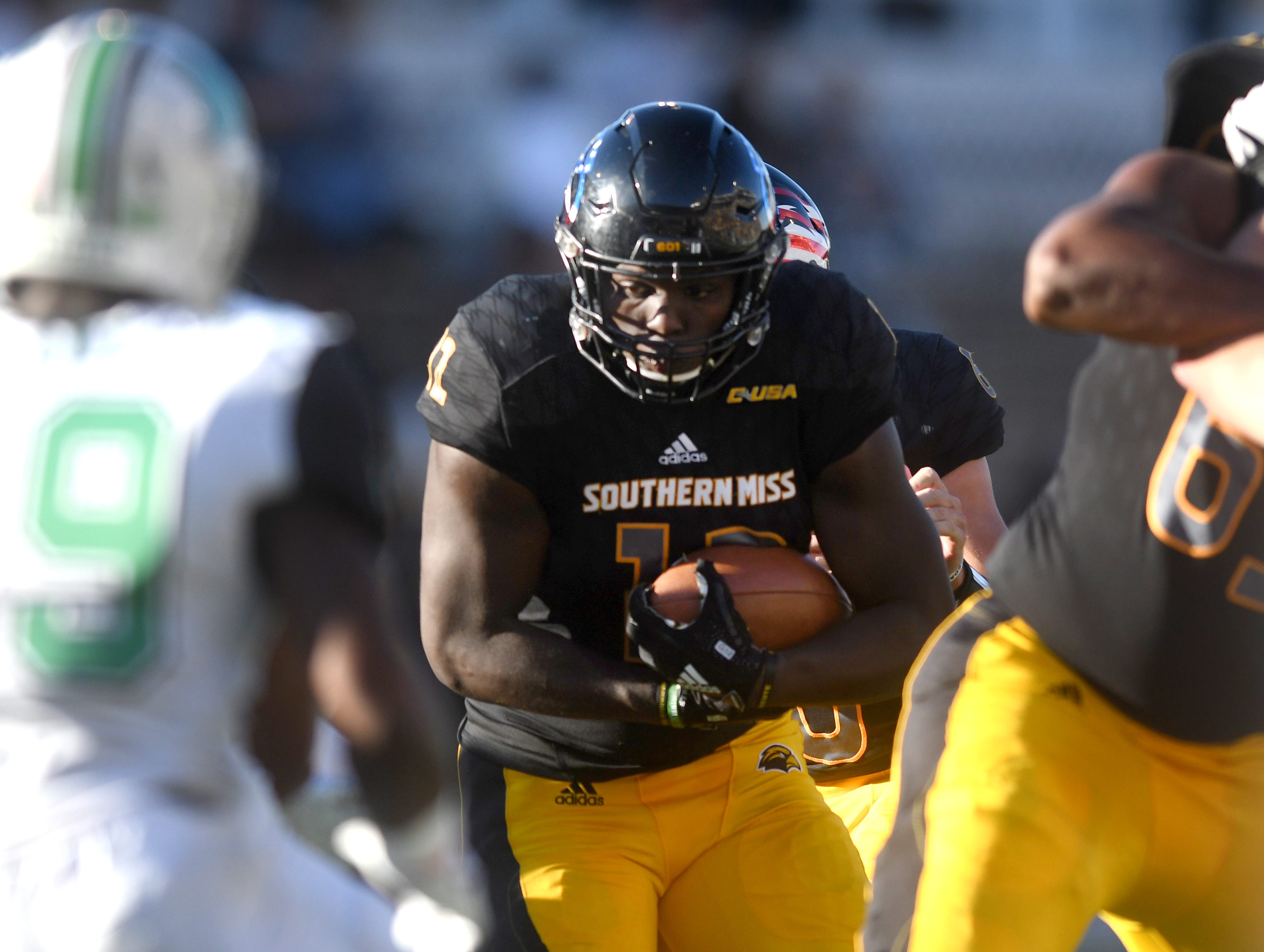 Southern Miss running back Steven Anderson carries the ball down the middle in a game against Marshall at M.M. Roberts Stadium on Saturday, November 3, 2018.