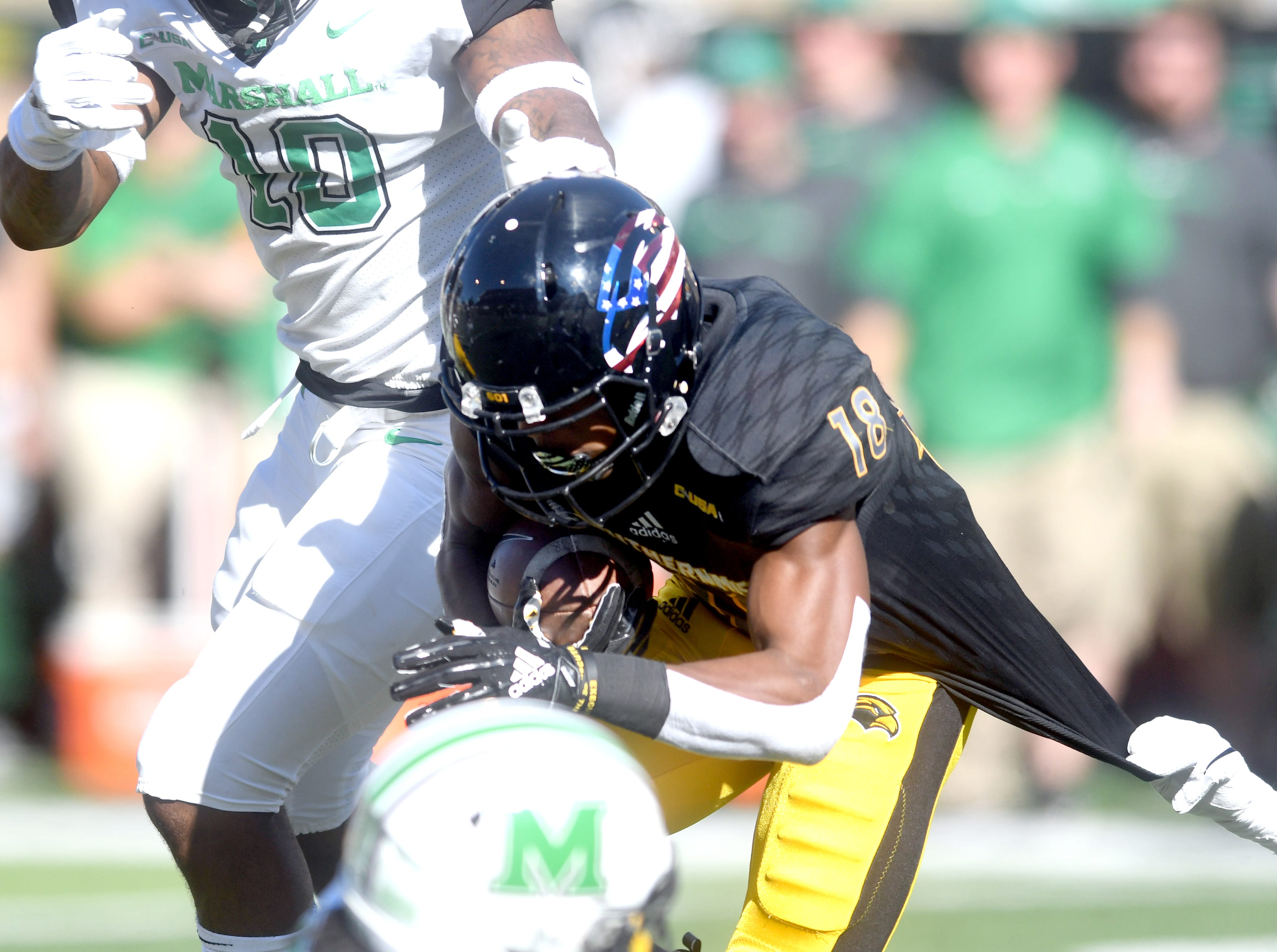 Southern Miss wide receiver De'Michael Harris returns the ball in a game against Marshall at M.M. Roberts Stadium on Saturday, November 3, 2018.