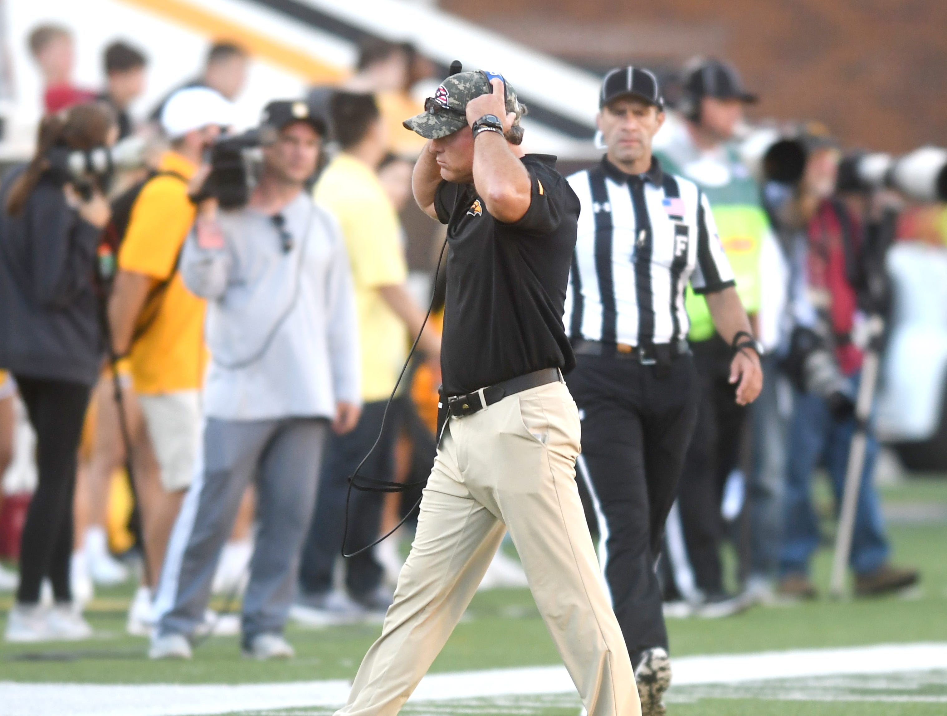 Southern Miss head coach Jay Hopson walks back to the sideline in a game against Marshall at M.M. Roberts Stadium on Saturday, November 3, 2018.