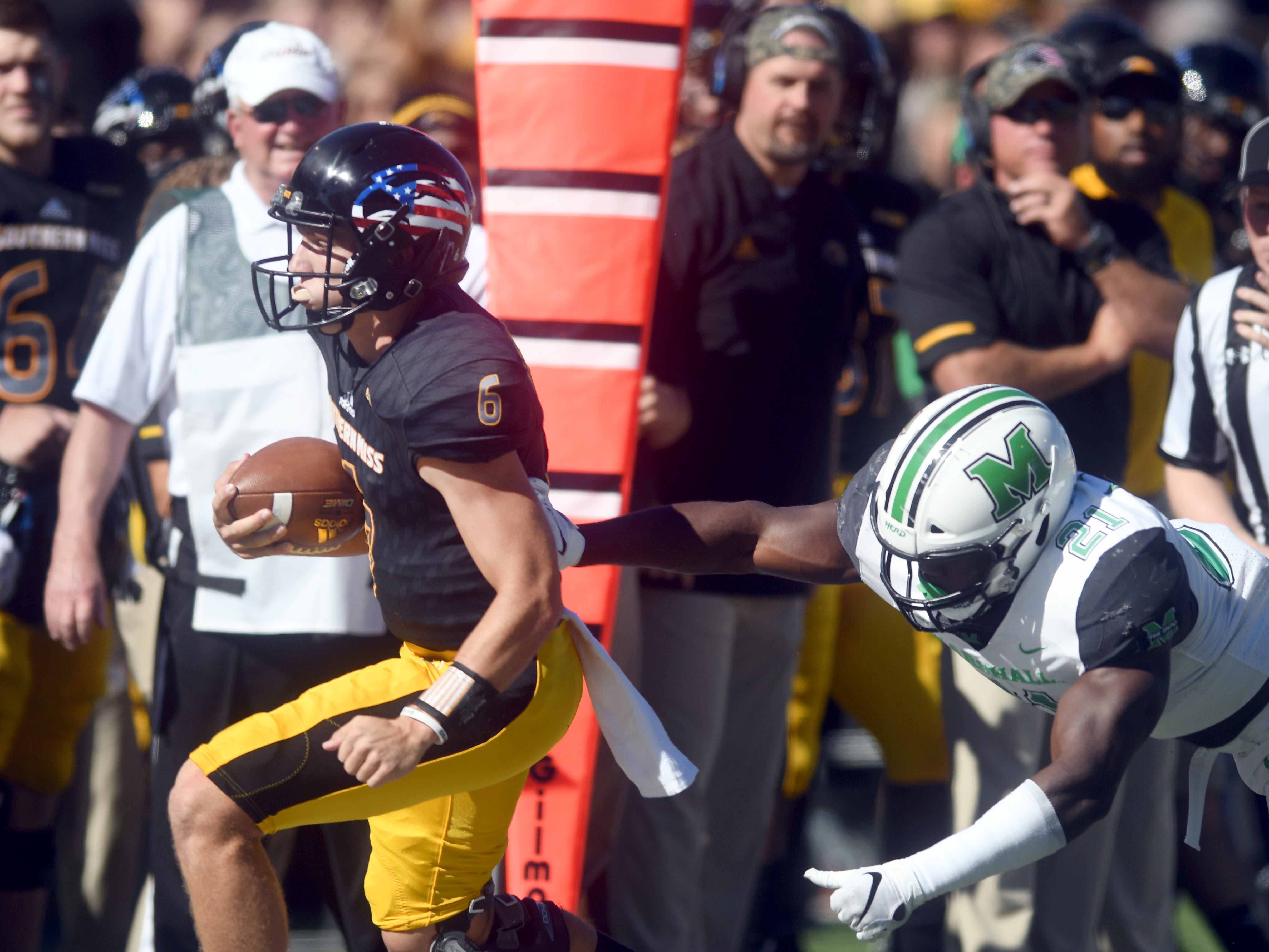 Southern Miss quarterback Tate Whatley carries the ball to the sideline in a game against Marshall at M.M. Roberts Stadium on Saturday, November 3, 2018.